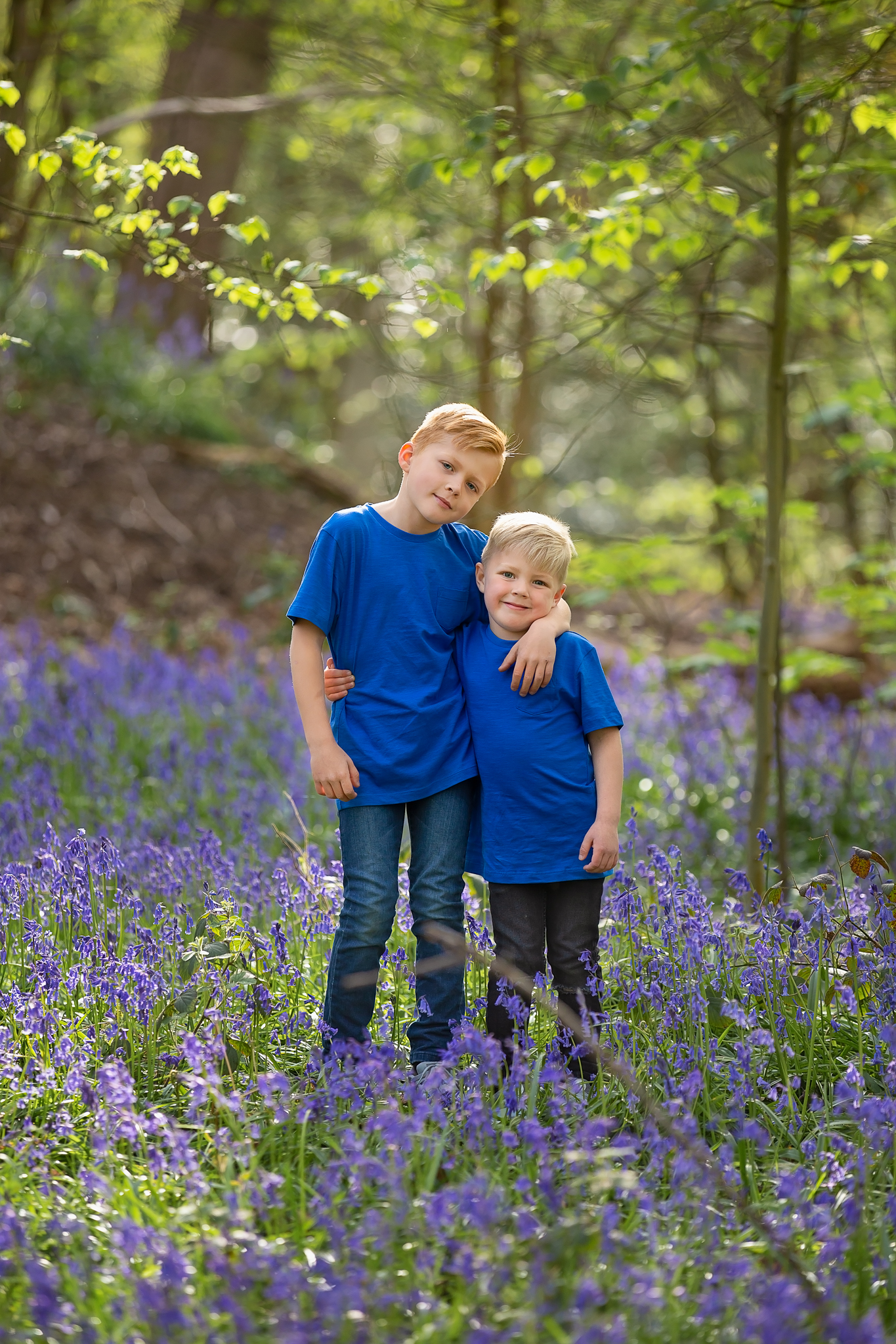 Children photographer Leeds, York, Harrogare, Bradford: brothers posing for a photo during bluebell session in Leeds, West Yorkshire