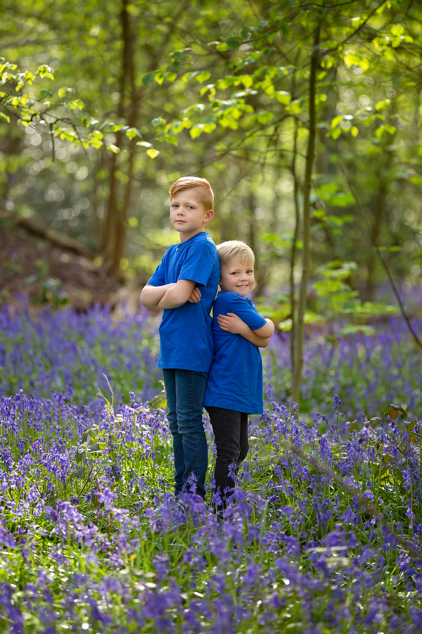Children photographer Leeds, York, Harrogare, Bradford: twin brothers during bluebell session in Leeds, West Yorkshire