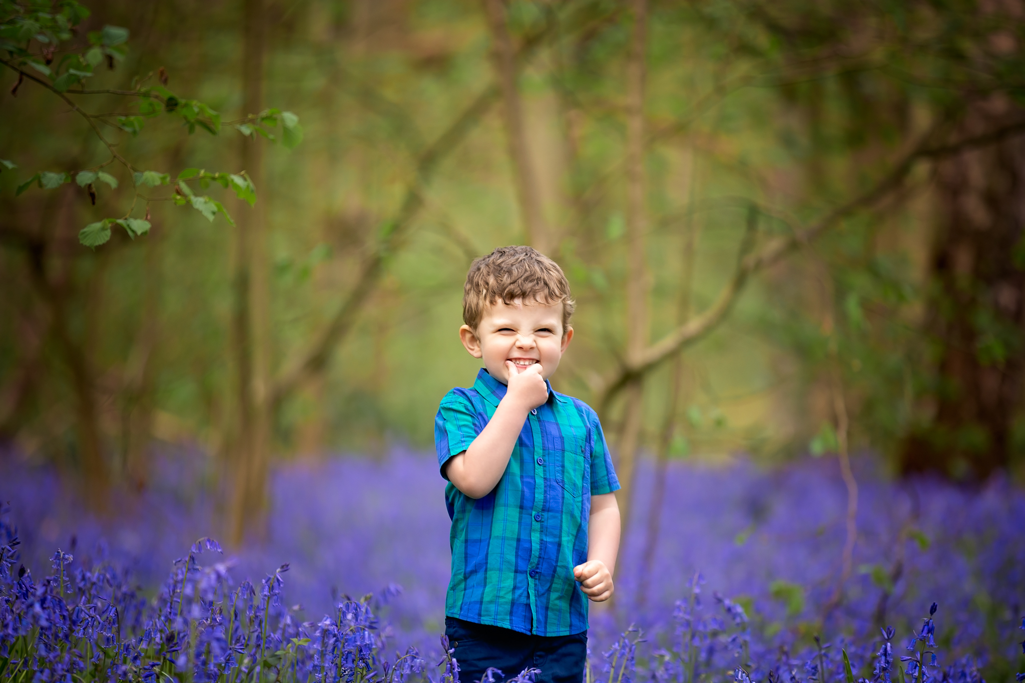 Child photographer Leeds, York, Harrogare, Bradford: cute little boy during bluebell session in Leeds, West Yorkshire