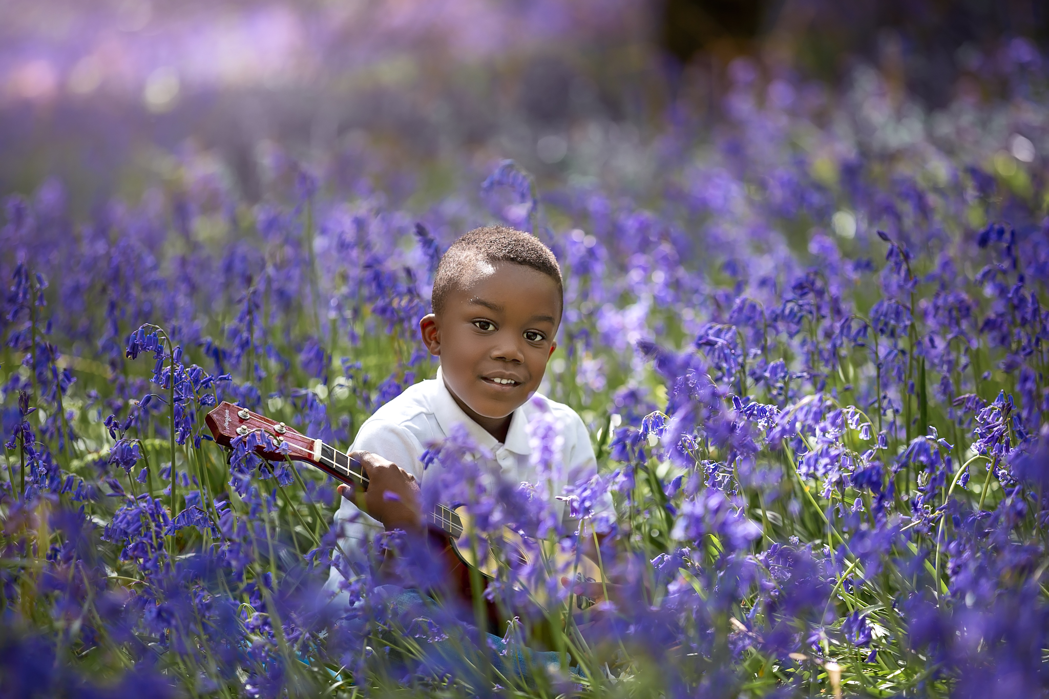 Child photography Leeds, York, Harrogare, Bradford: little boy with a guitar in a bluebell wood