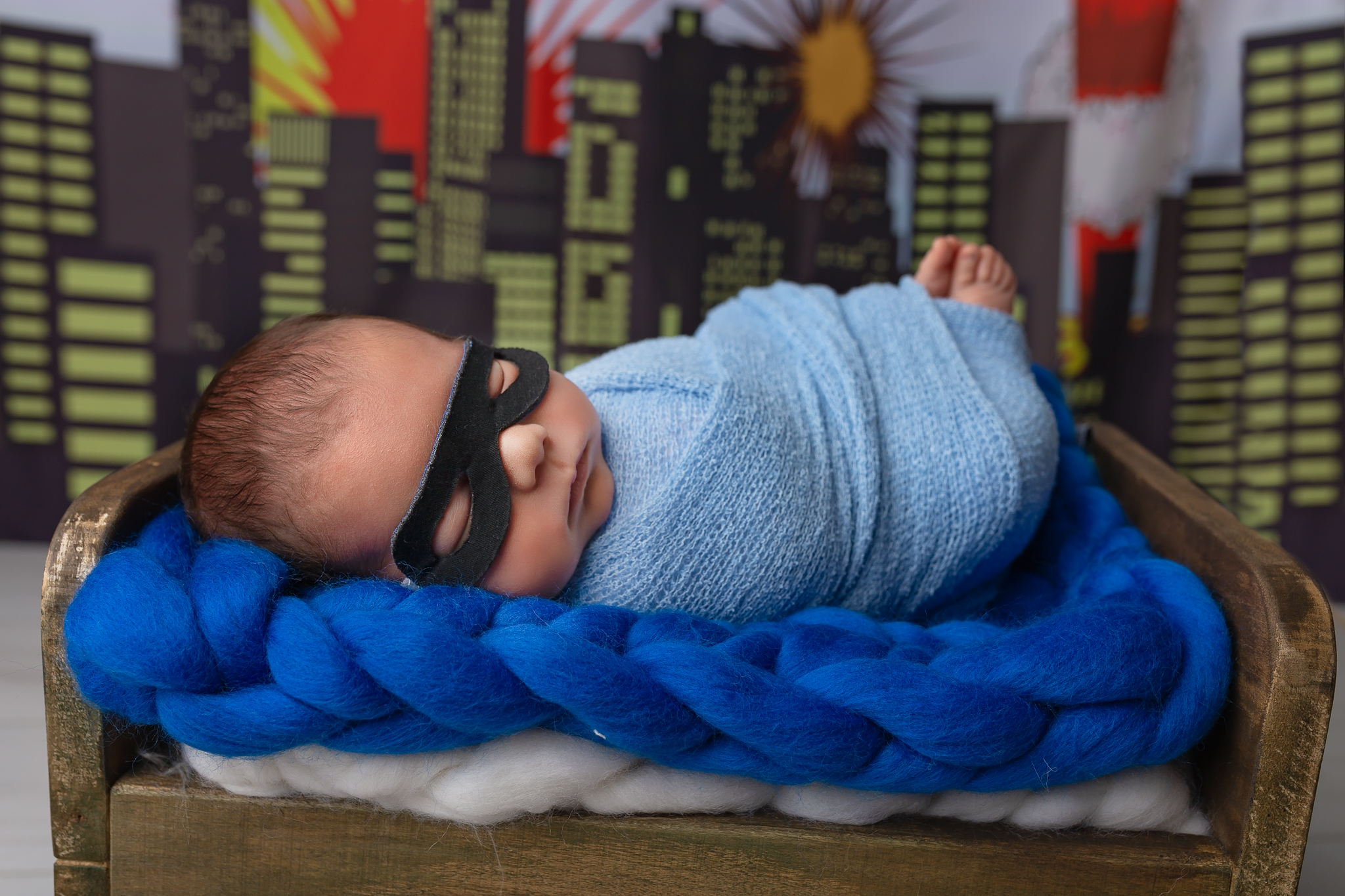 Newborn photographer Leeds, York, Bradford, Harrogate, Wakefield: newborn baby boy styled as a superhero during his newborn photoshoot in Leeds, West Yorkshire