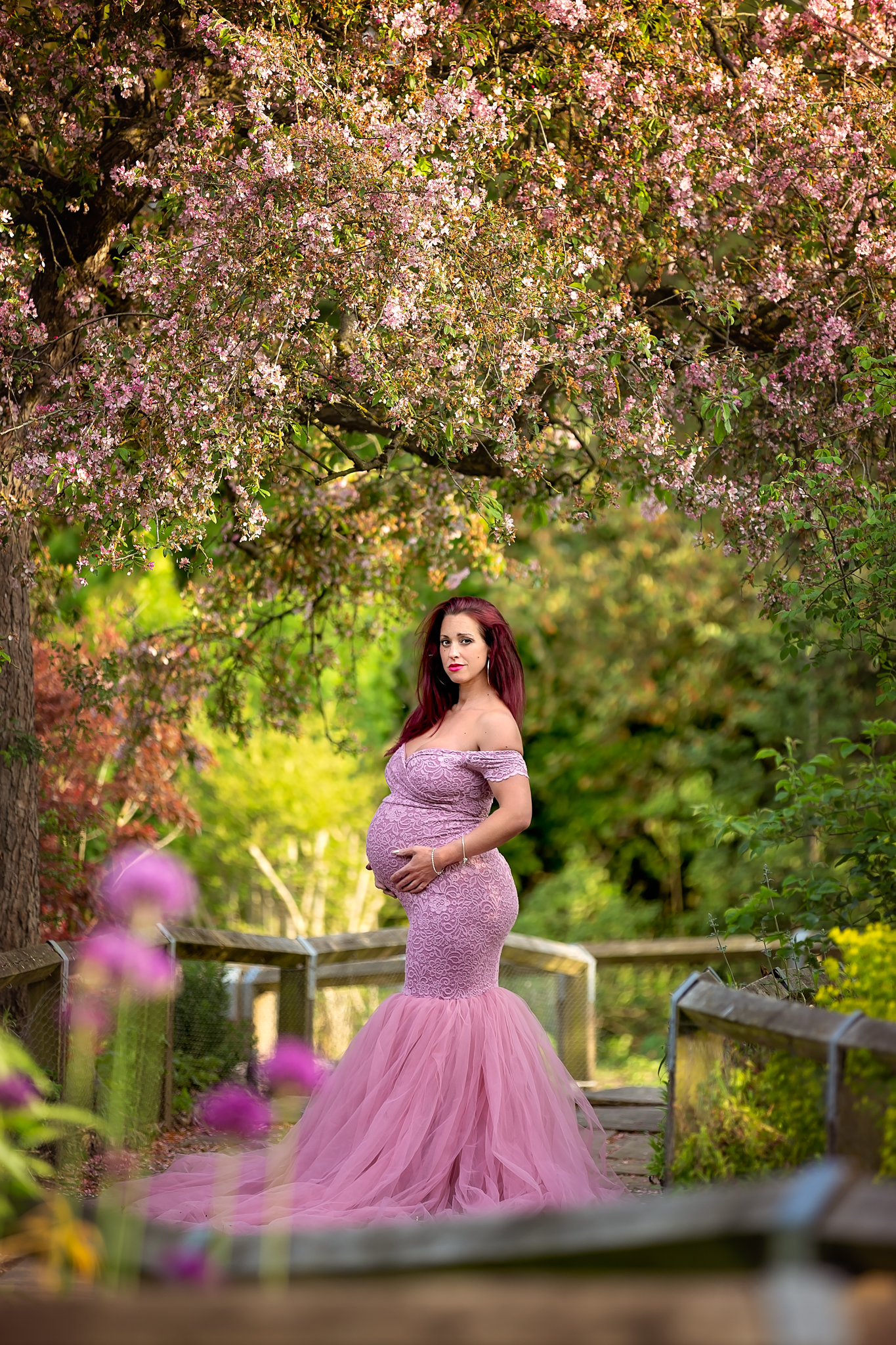 Maternity photographer Leeds-York-Harrogate-Bradford-Wakefield: beautiful pregnant woman in a long purple dress posing for a maternity photo in Leeds, West Yorkshire