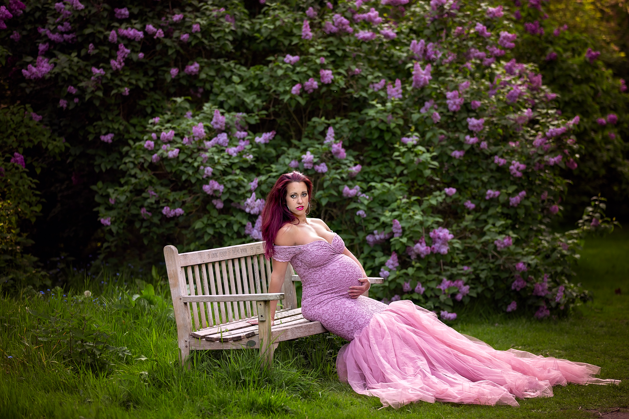 Maternity photographer Leeds-York-Harrogate-Bradford-Wakefield: beautiful pregnant woman in a stunning pink dress during her pregnancy photoshoot in Leeds, West Yorkshire