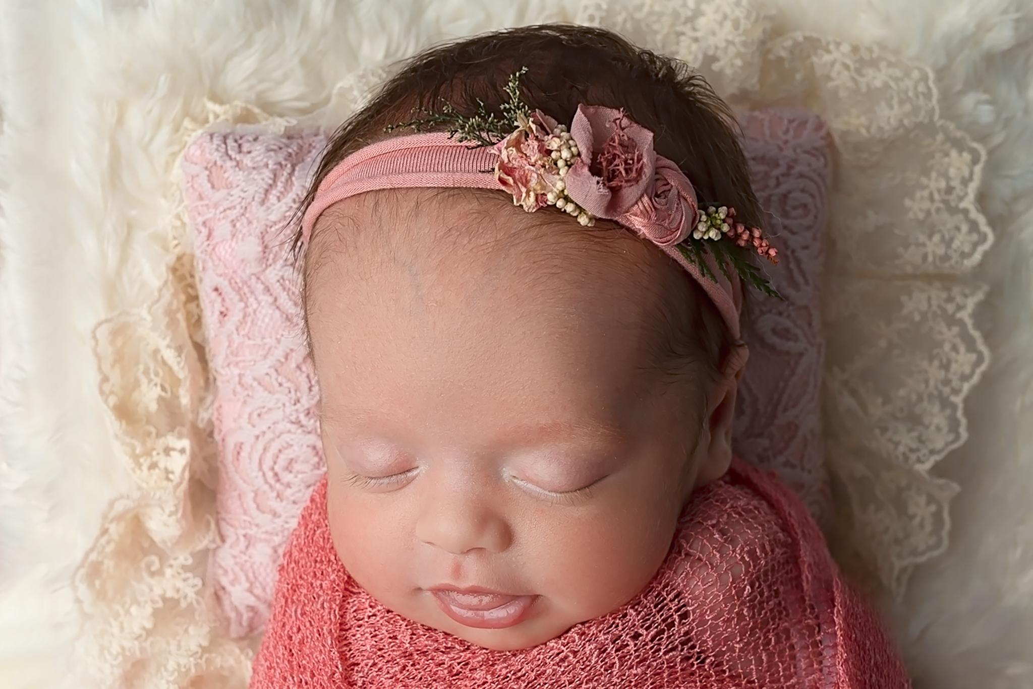 Professional newborn photography Leeds-York-Bradford-Harrogate-Wakefield: newborn baby girl sleeping in a bed during her newborn photoshoot in Leeds, Yorkshire