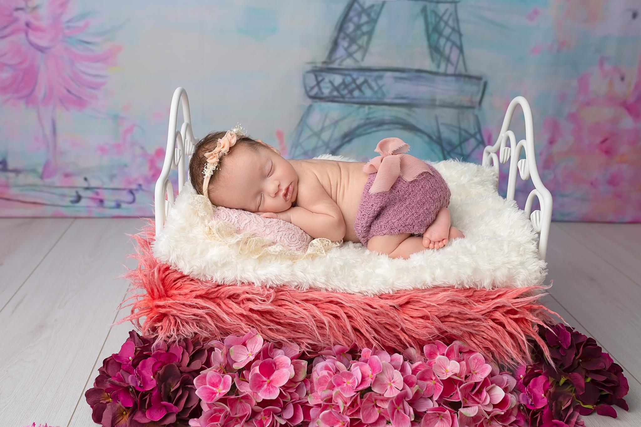 Professional newborn photography Leeds-York-Bradford-Harrogate-Wakefield: newborn baby girl sleeping in a cute little bed during her newborn photoshoot in Leeds, Yorkshire