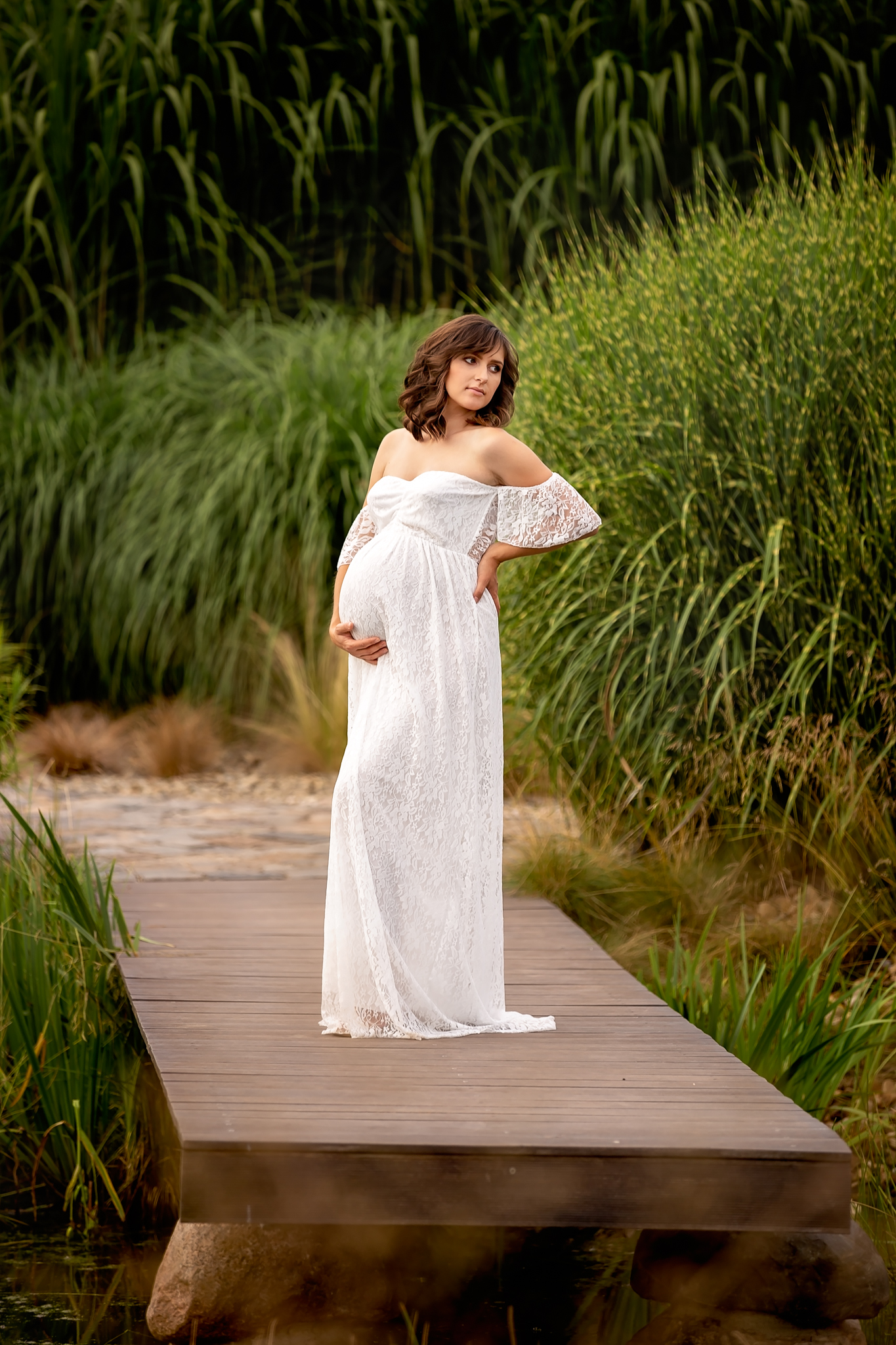 Professional maternity photographer Leeds, York, Bradford, Wakefield, Harrogate: beautiful young pregnant woman posing for a pregnancy photo in a rustic garden