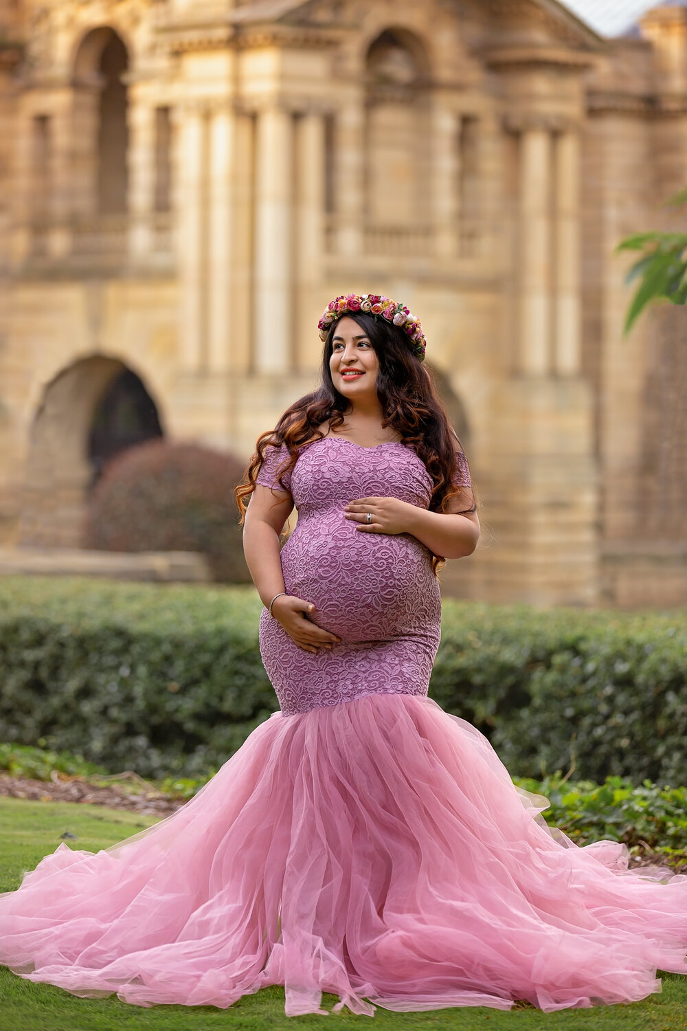 Professional maternity photography Leeds, Bradford, York, Harrogate, Wakefield: beautiful expecting mum in a stunning log gown posing for a pregnancy picture in Bradford, West Yorkshire