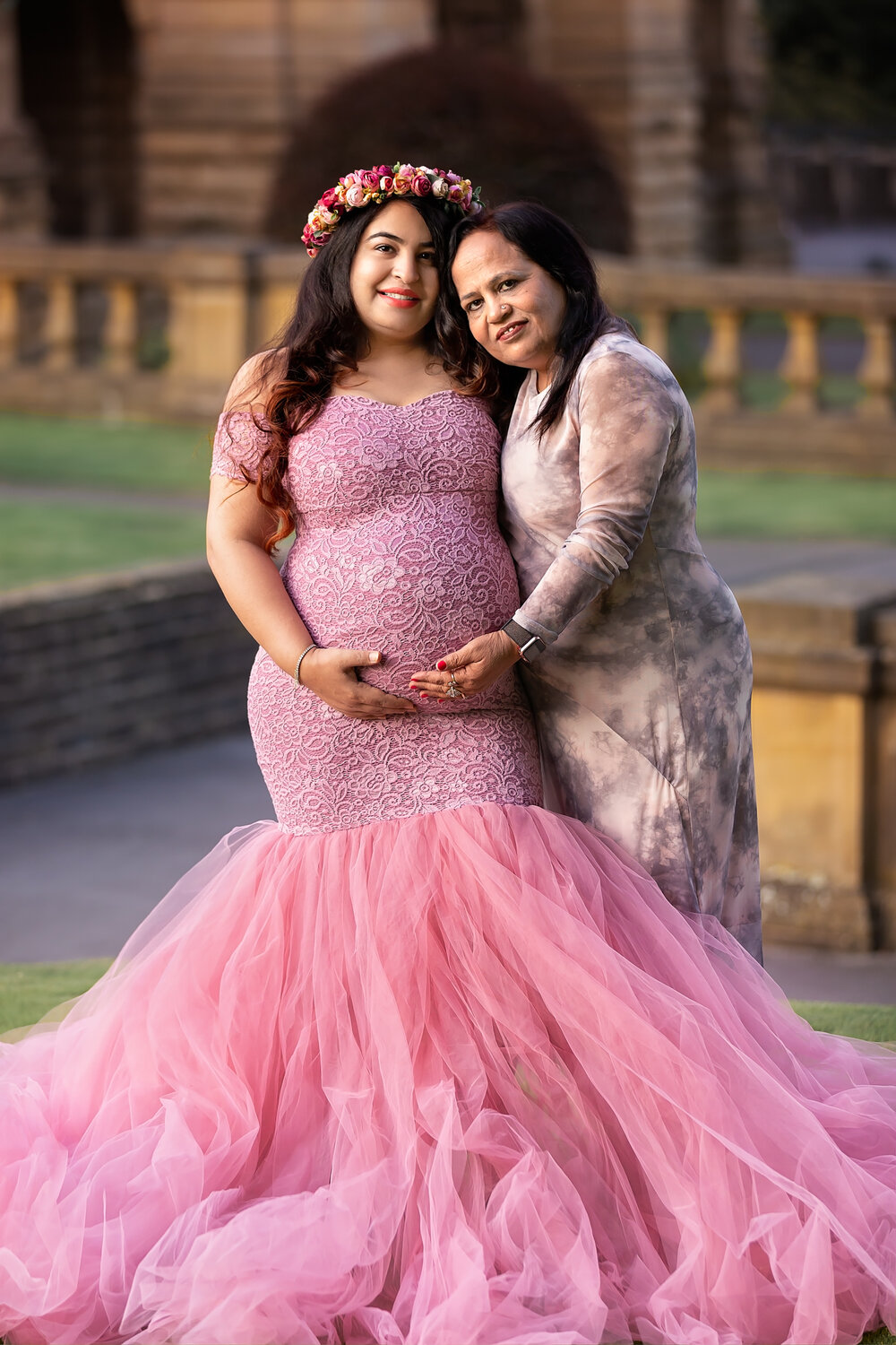 Professional maternity photography Leeds, Bradford, York, Harrogate, Wakefield: beautiful expecting woman in a stunning log gown posing for a pregnancy picture with her mum in Bradford, West Yorkshire