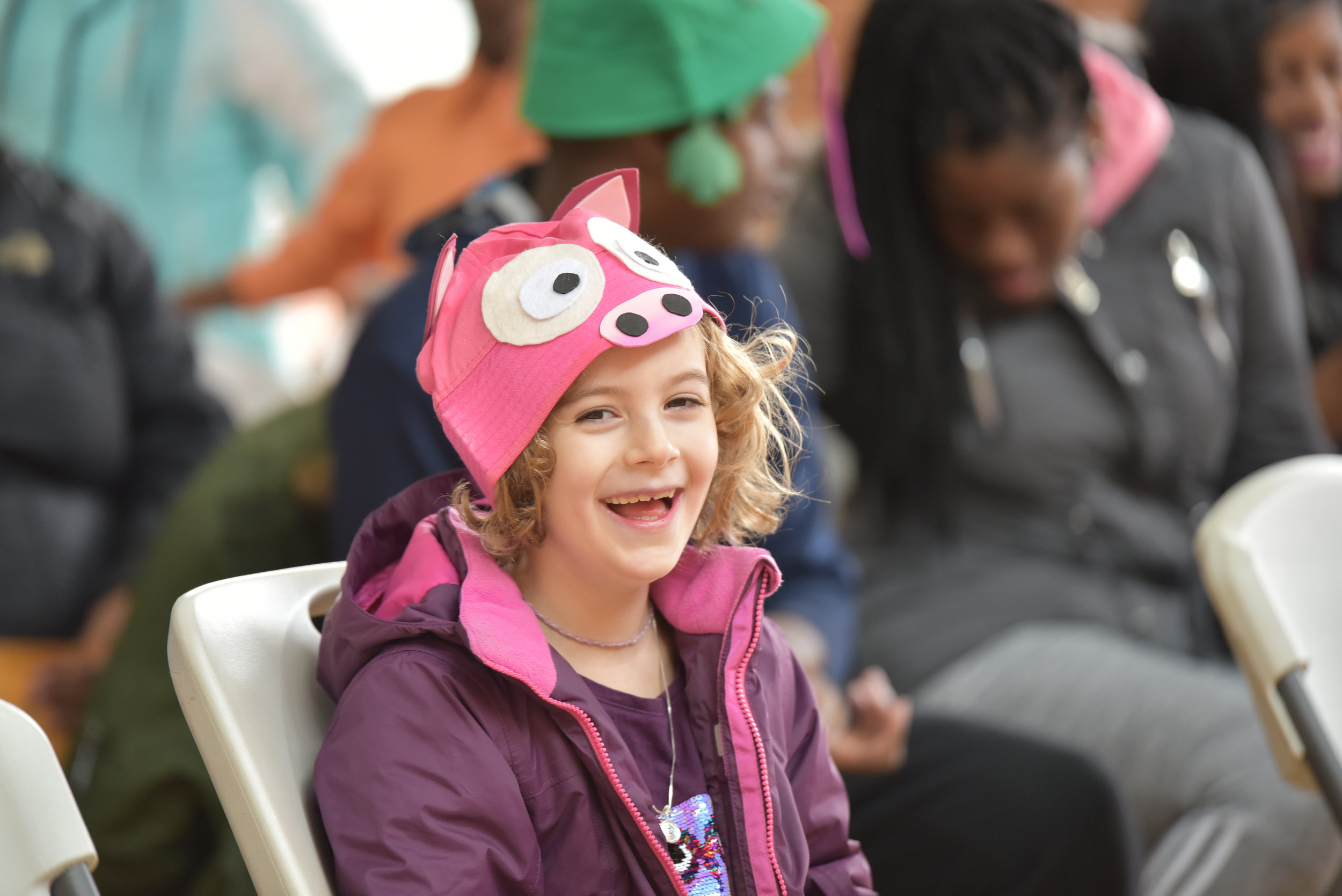 Child smiling during children's theatre performance