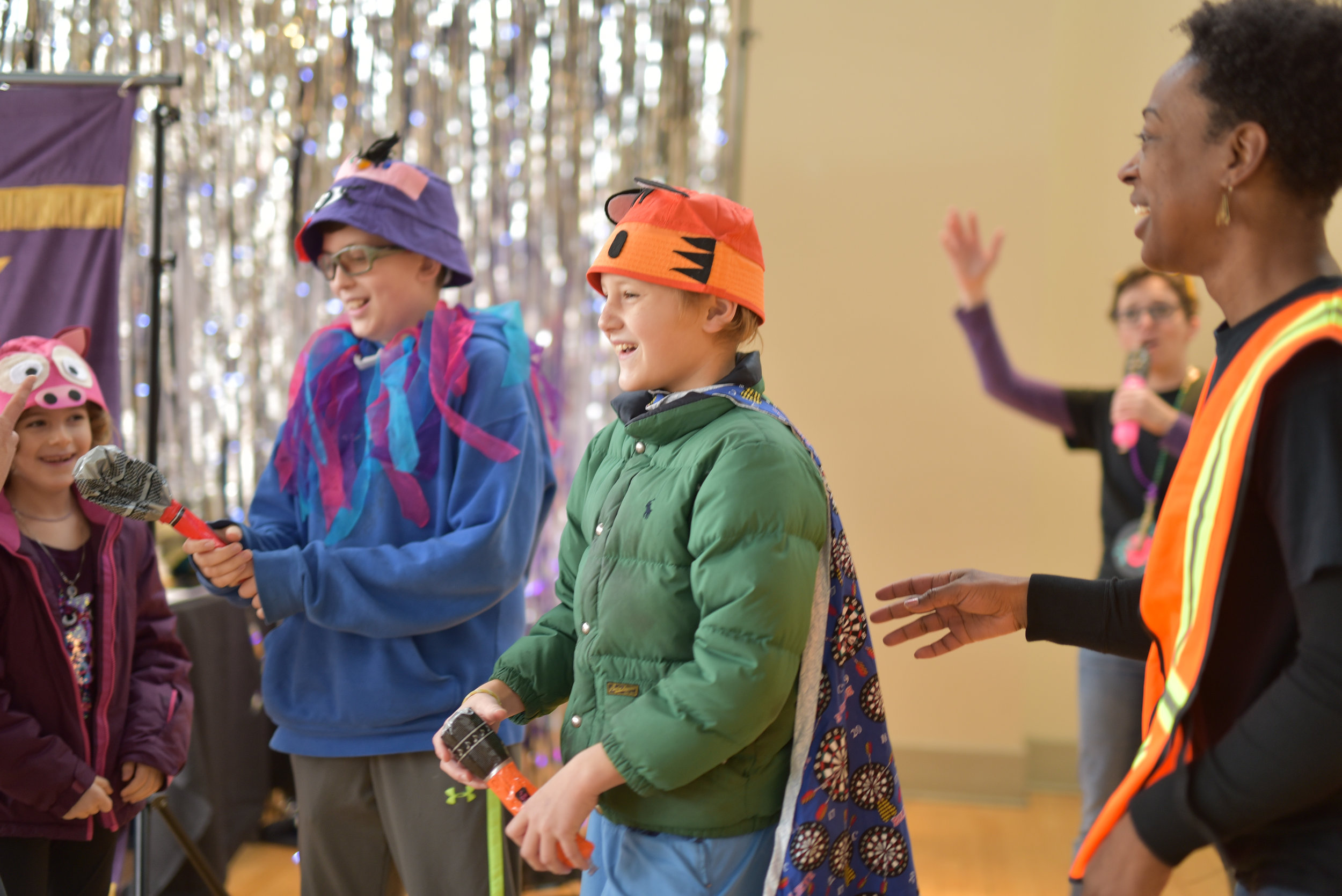 Children and actor playing during children's theatre performance