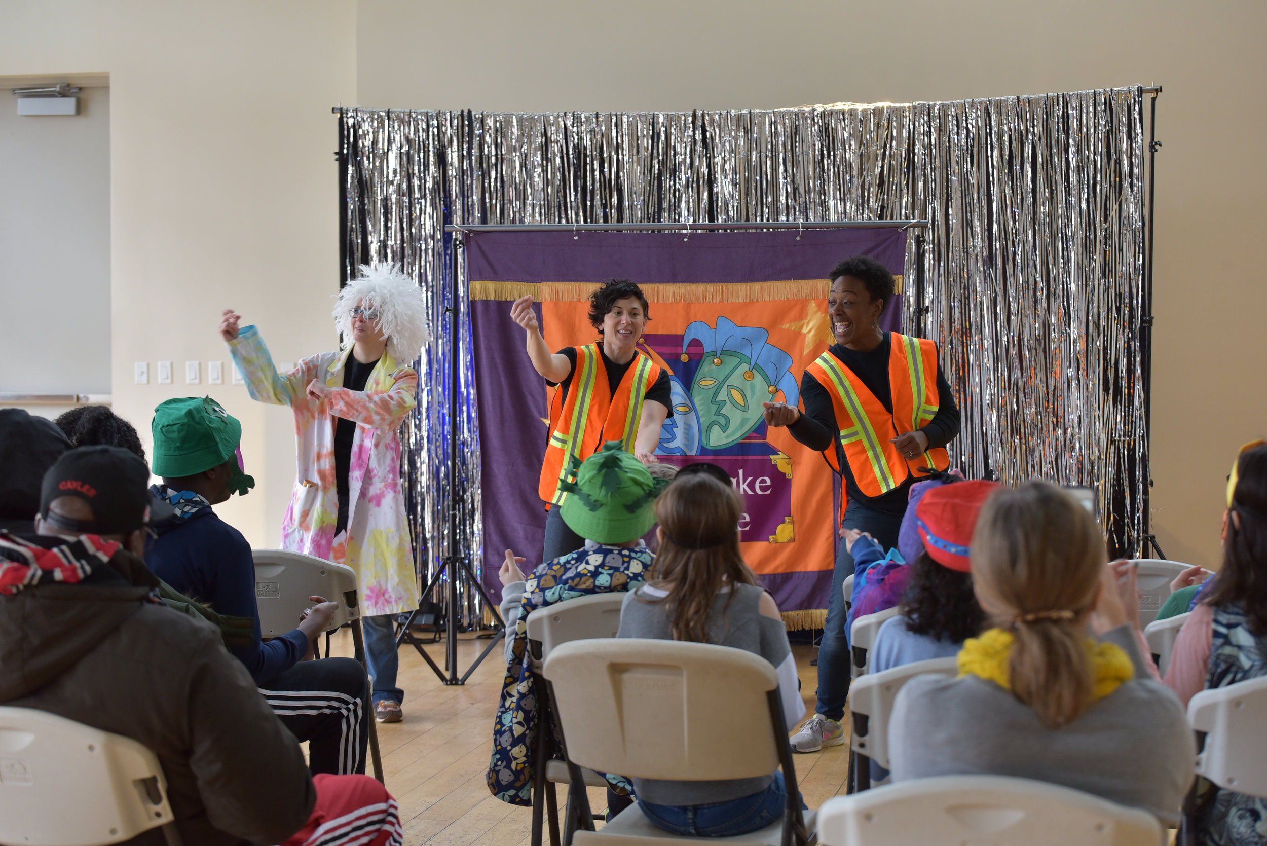 Actors dancing during children's theatre performance