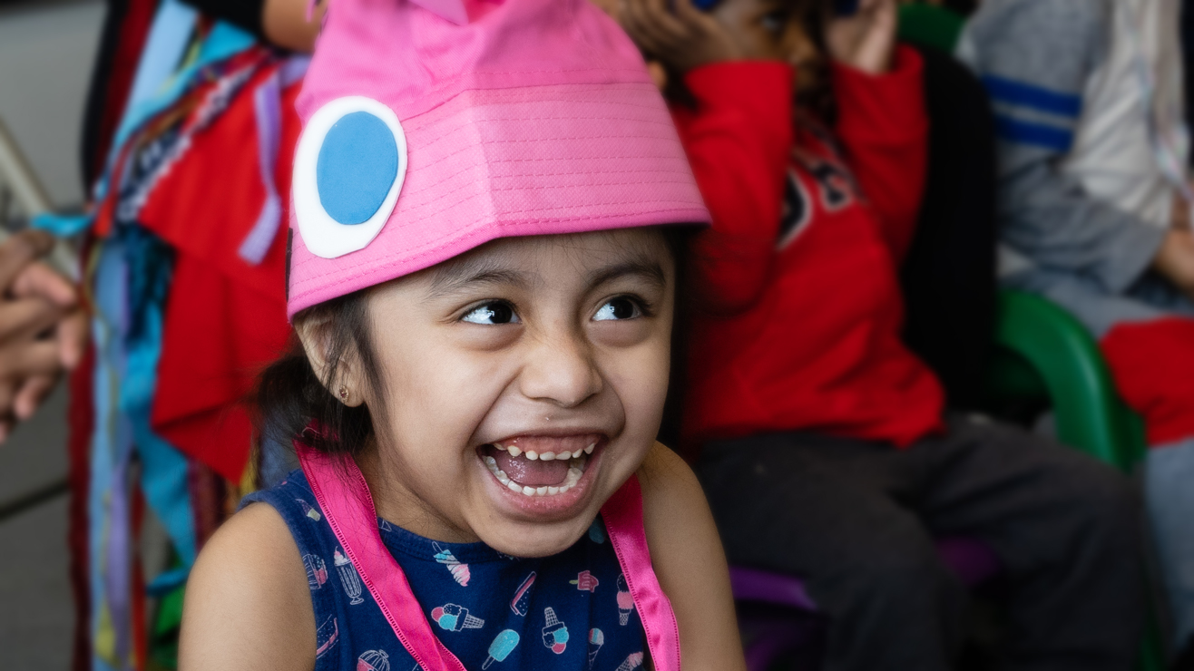 Child laughing during children's theatre performance