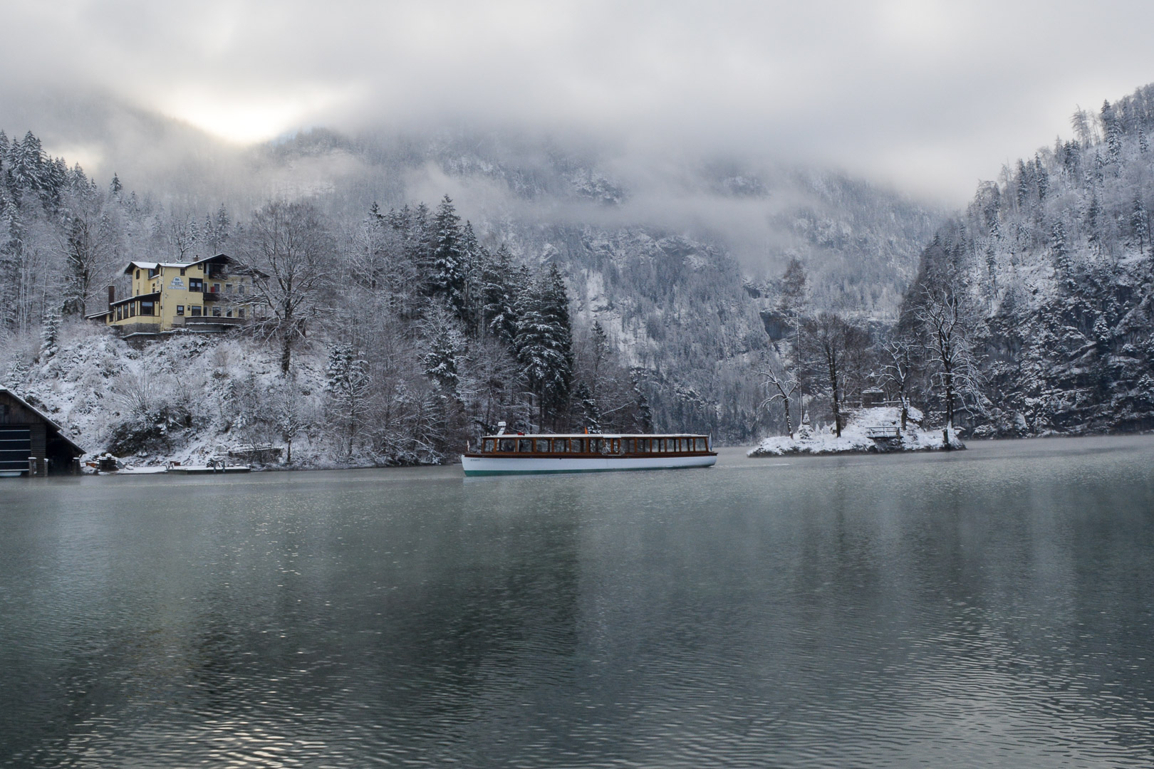 A ferry making its journey across the lake