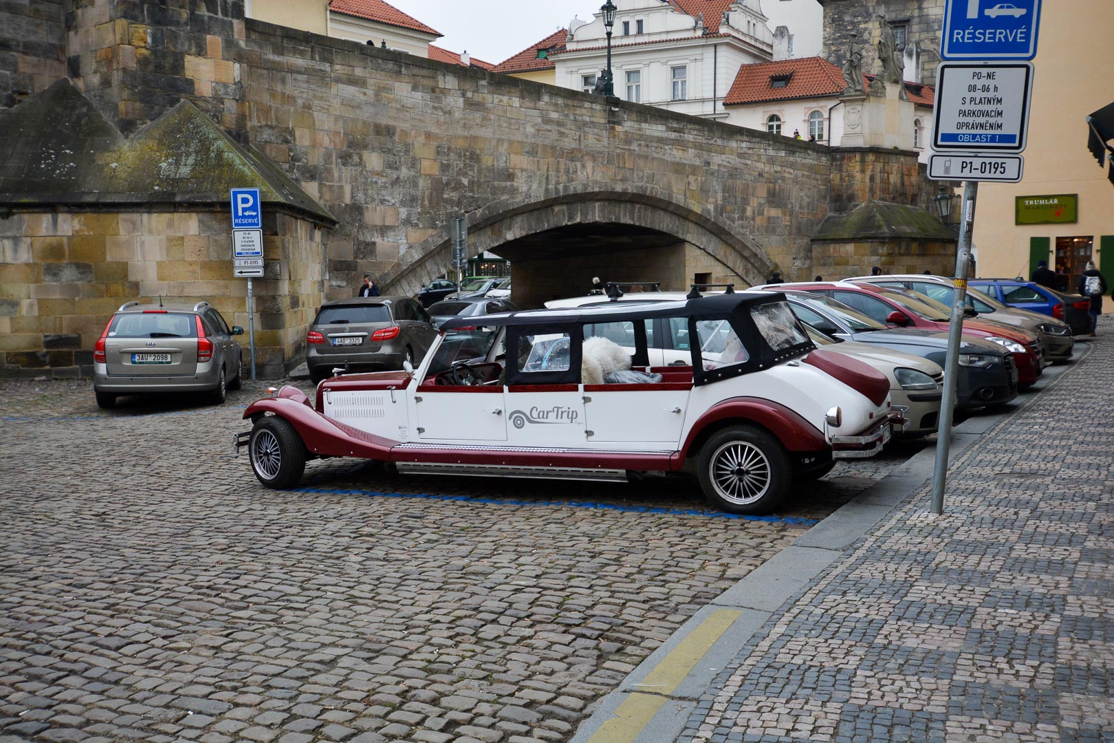 We saw a few of these old extended cars driving around Old Town—looks like a great way to see the city