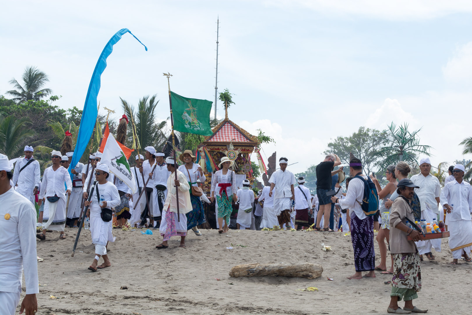 A temple's community making their way to the ocean for purification