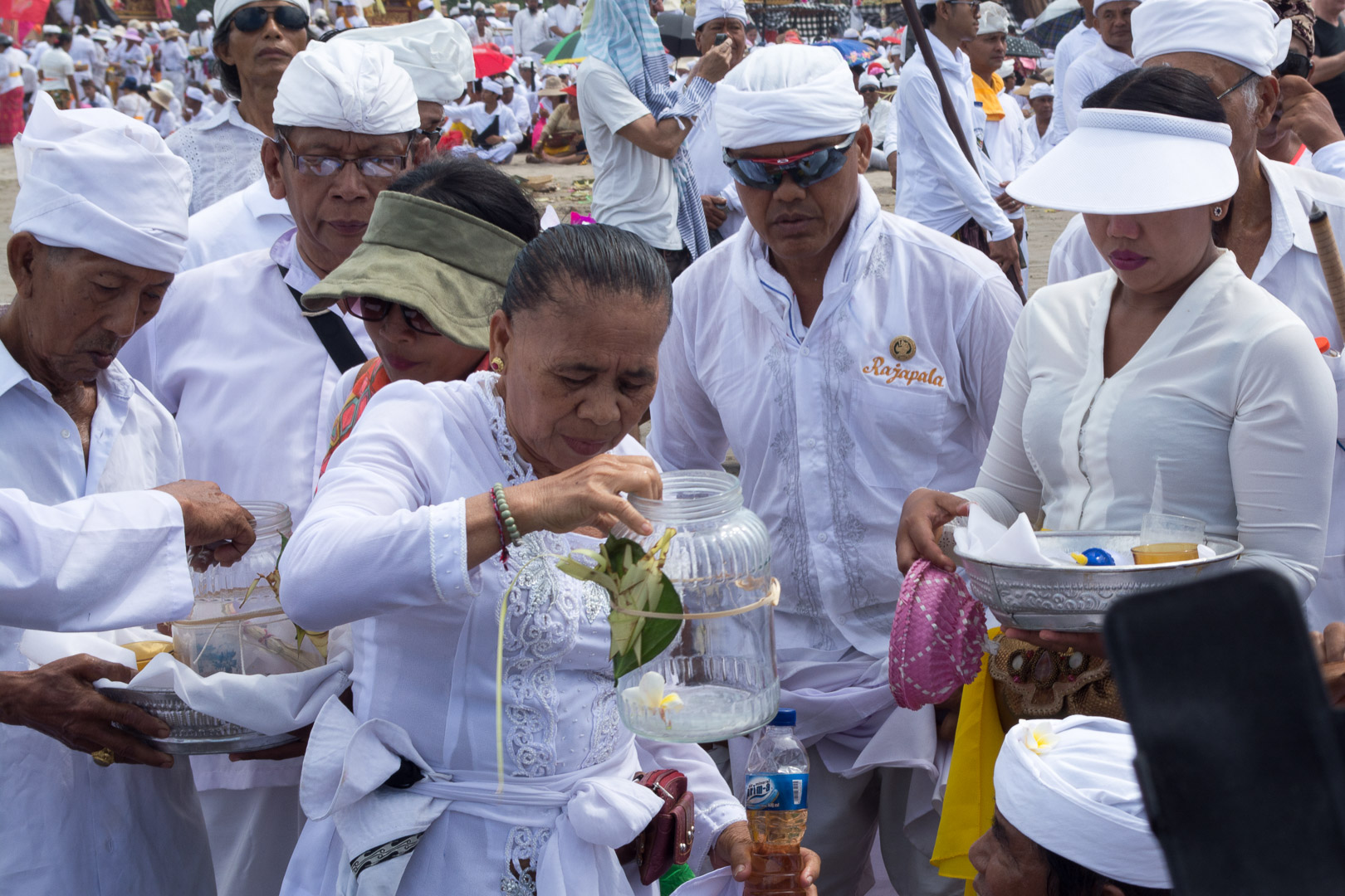 A woman with ocean water splashes everybody and shrine objects for purification