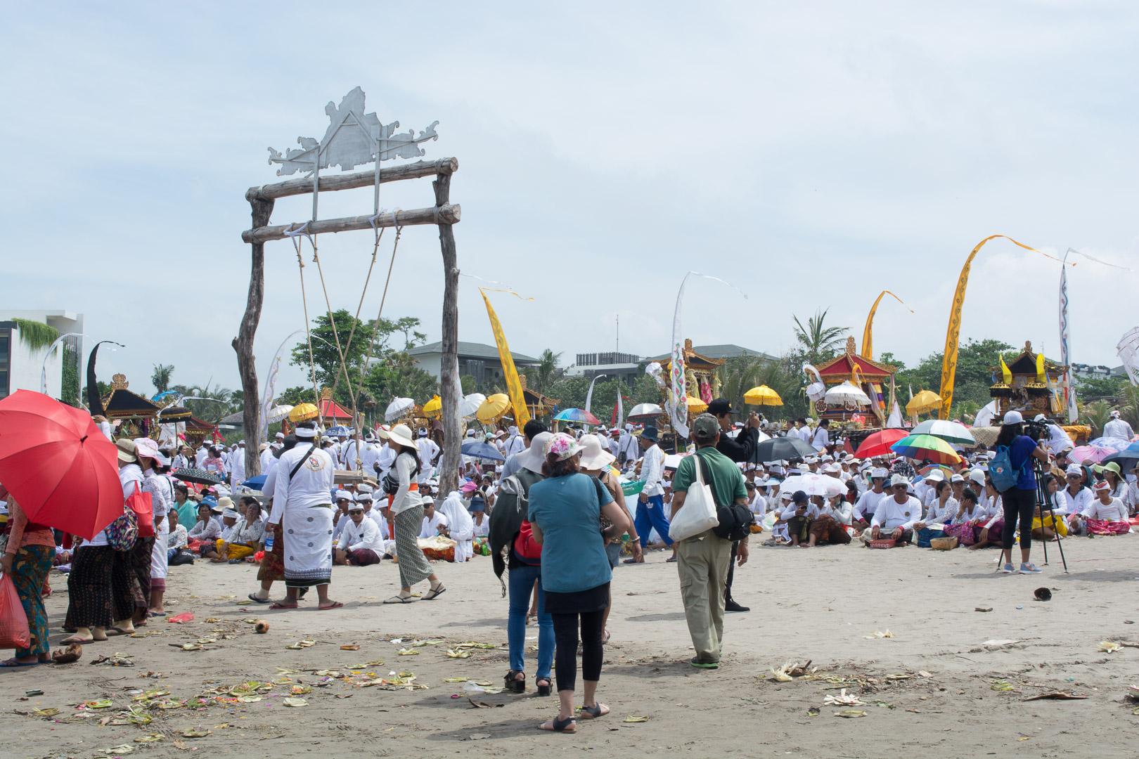 People praying towards the ocean