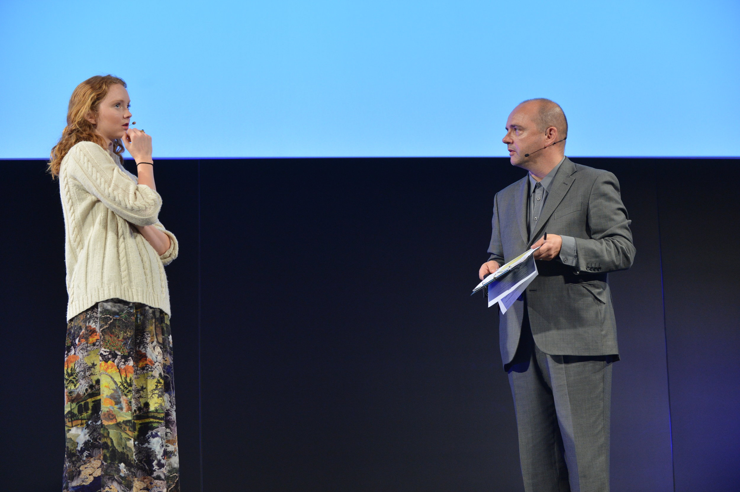 Pat hosting FutureFest in 2013, on stage with entrepreneur and actress Lily Cole