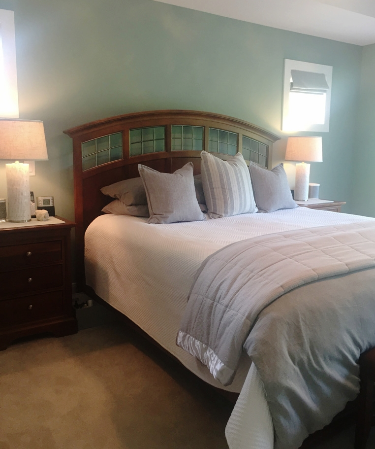 Keep bedding neutral, beds fixed, and nightstands decluttered.