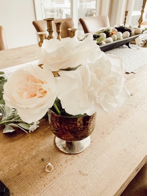Arrange major flowers around sides and top