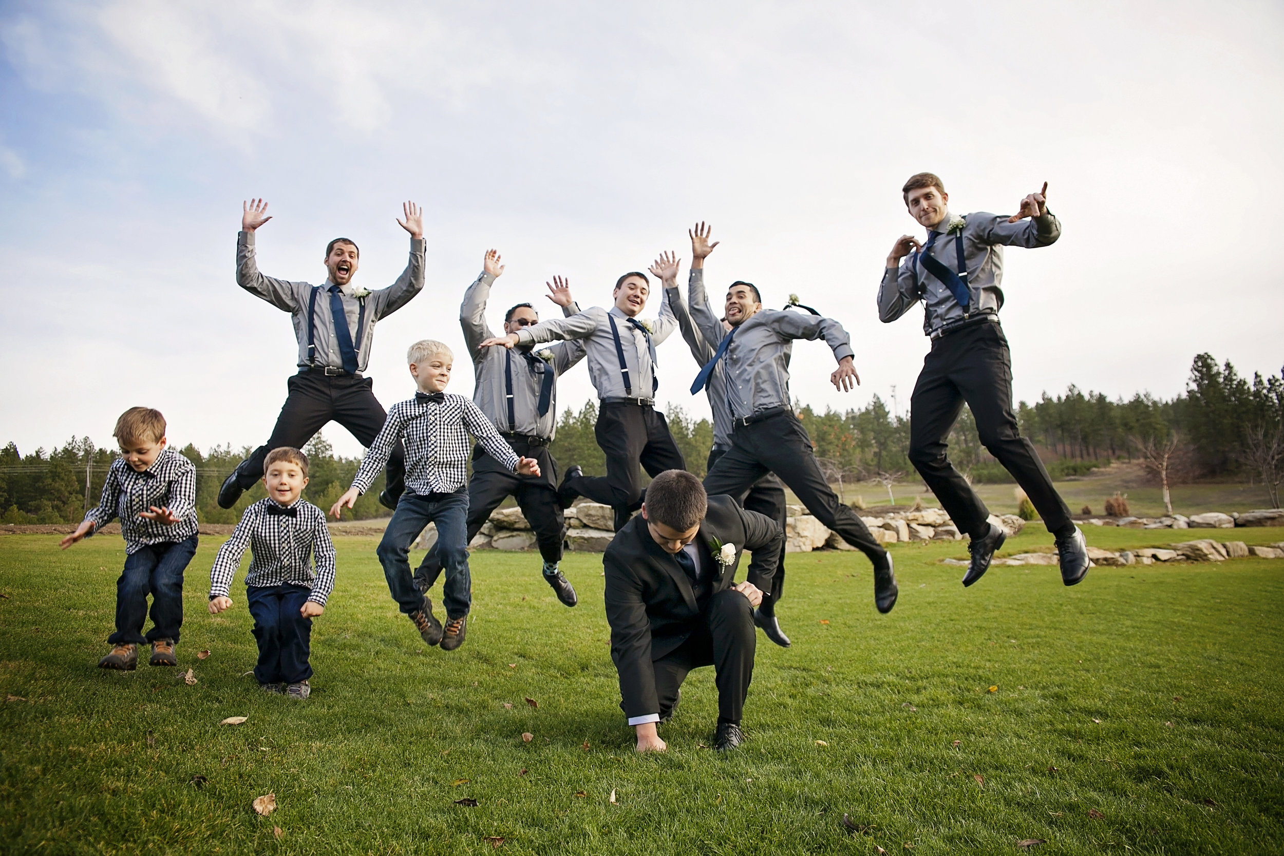 Wedding at Beacon Hill events with groomsmen jumping in the air by local Spokane wedding photographer Nate Robinson Photography