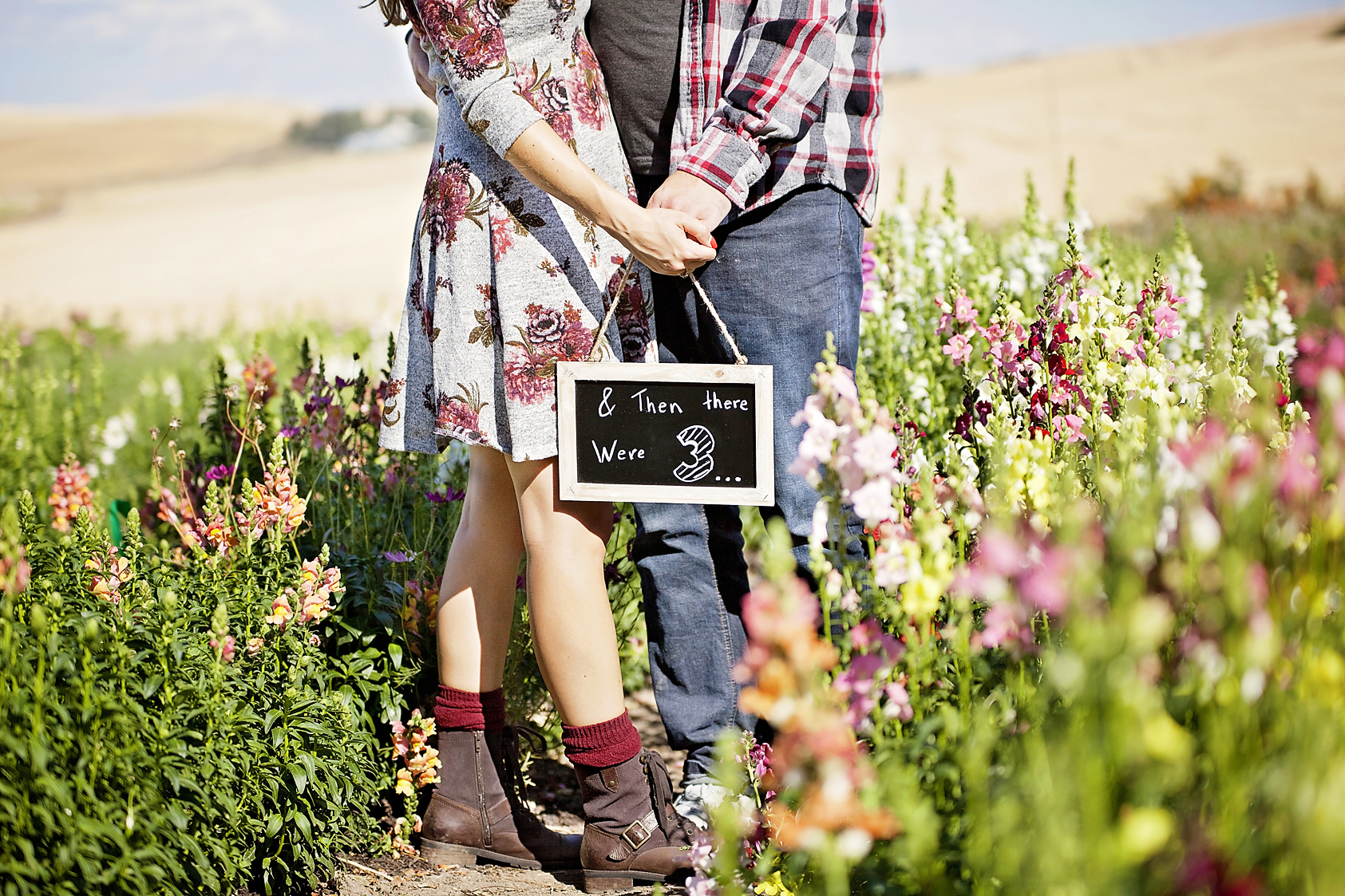 Pullman Photographer takes baby announcement/ maternity photos for WSU swing dance friends in Strattons Cutting Garden