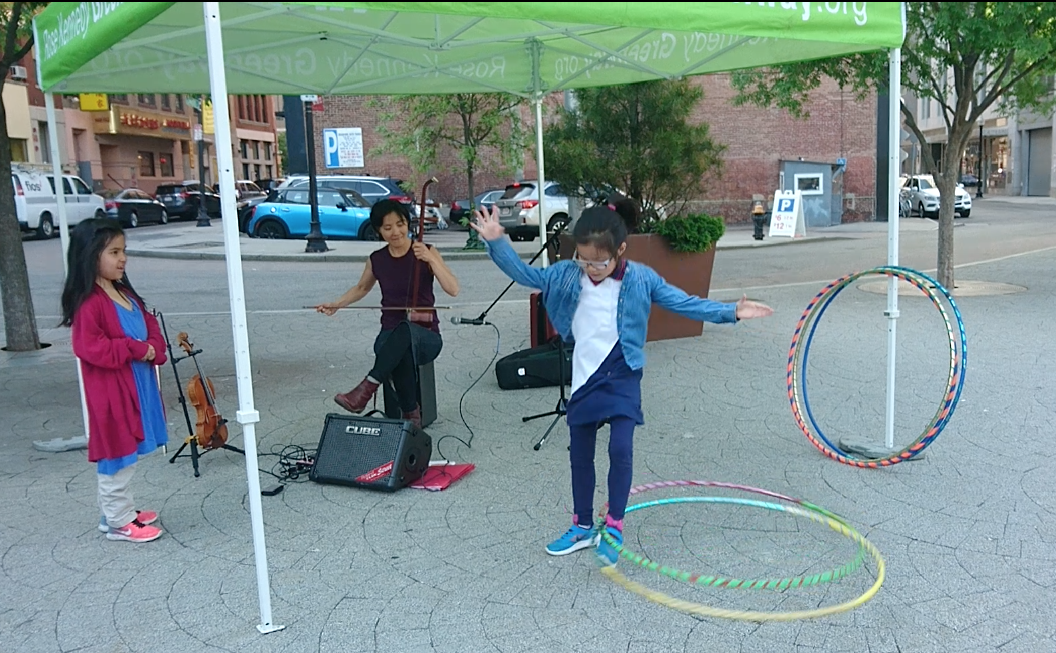 Probable world premiere of  erhu  racing horses and hula hoop duet! International Song Exchange at the Chinatown Gate/ Greenway park