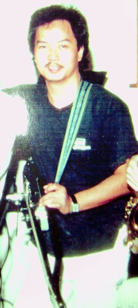Alex Wan with Instrument