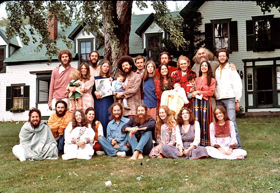 The woman in blue is holding a picture of Ram Dass' guru, Neem Karoli Baba and RD is in the back row, second from right. (I did not take this picture.)