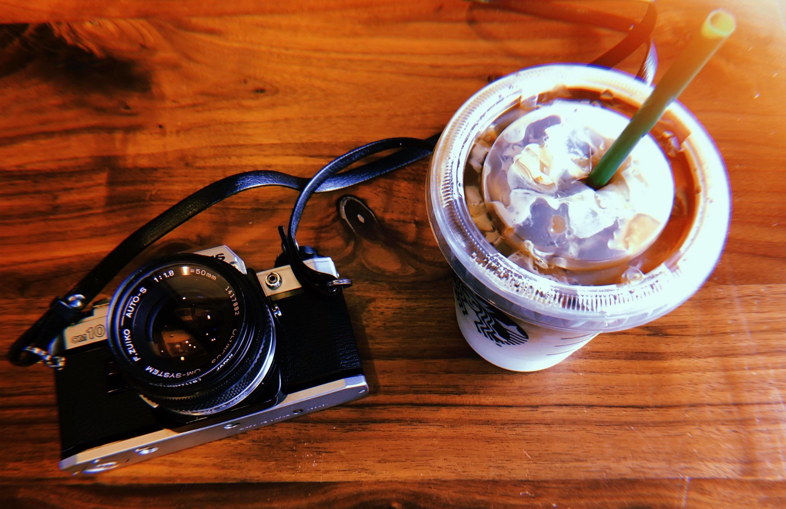 The Olympus OM-10. (Starbucks drink not included) iPhone photo.