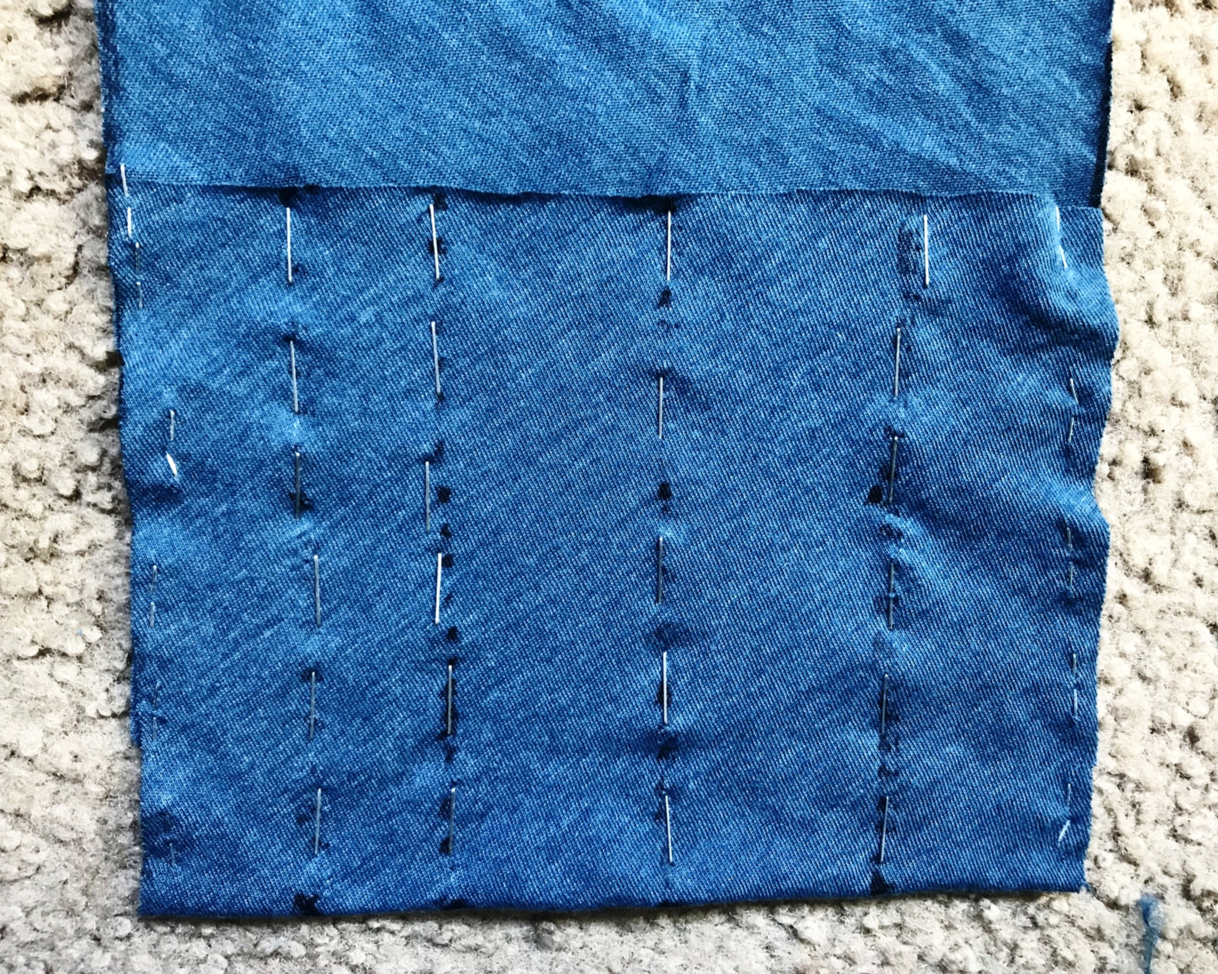 Tall pouch is divided into increments and stapled.
