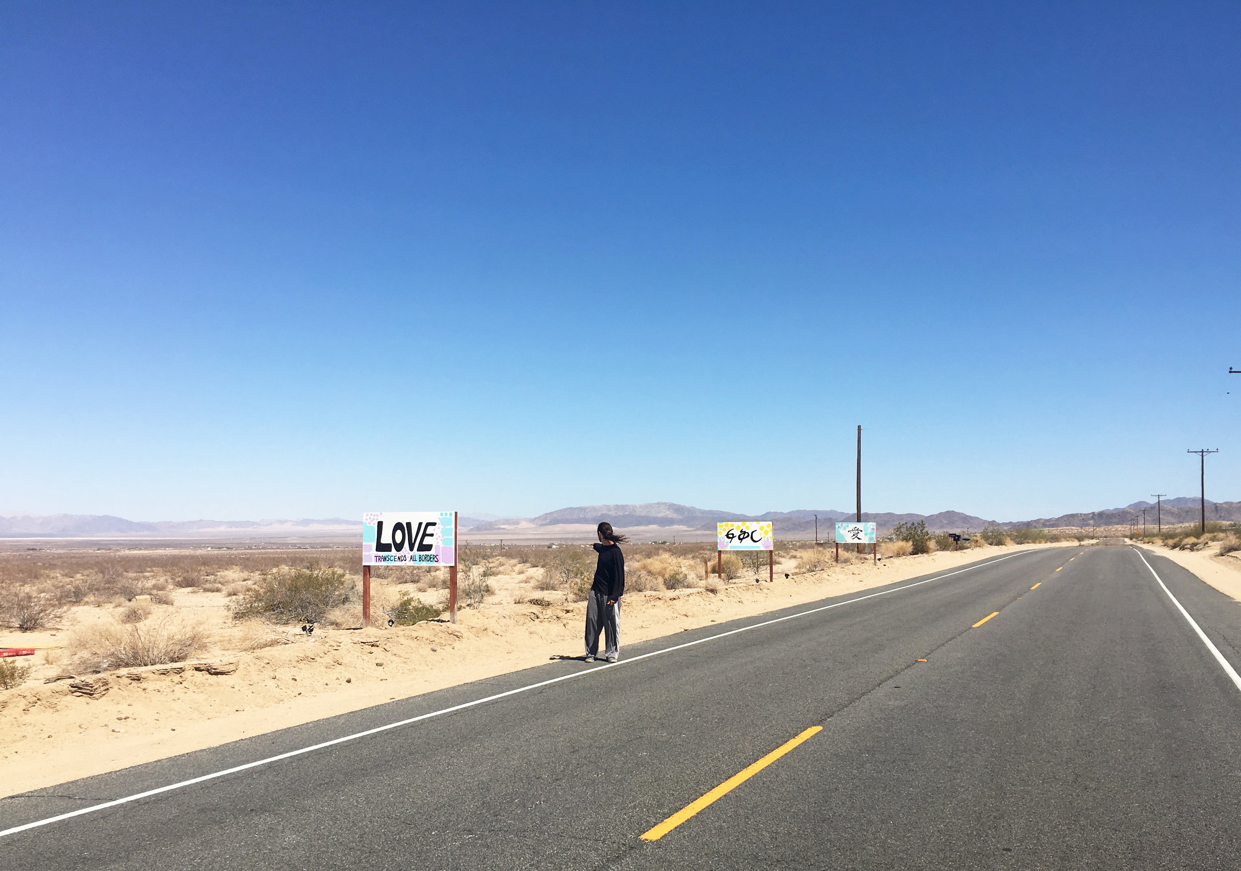 Heading East on Highway 62 from Twentynine Palms towards Wonder Valley, you'll see the Love Signs on the left hand side of the road. See the signs on  Google Maps.  Pictured with Jose Deangulo.