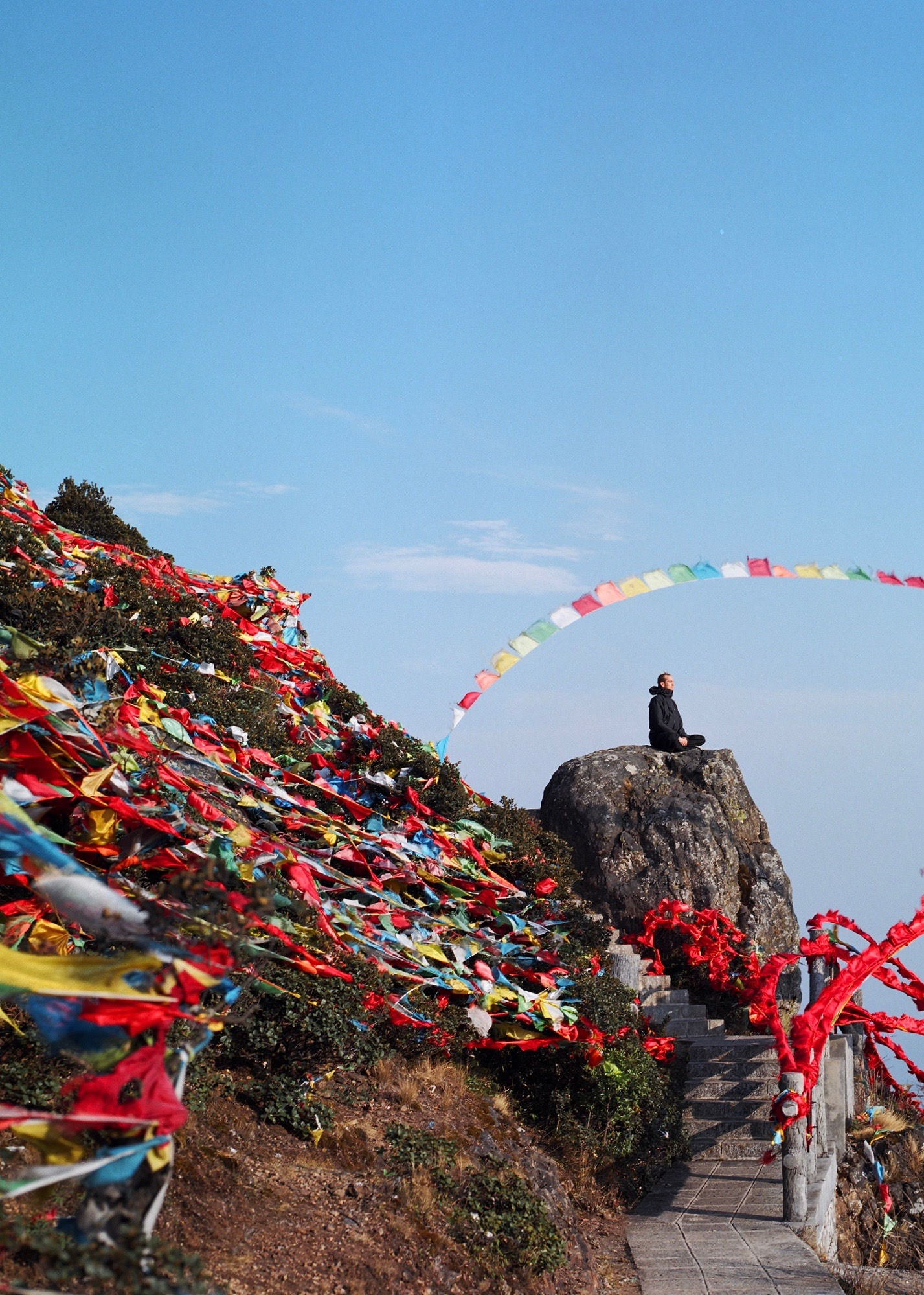 Prayer flags catch the breeze at a mountain temple (Yunnan, China)   Photo credit: Chip Roundtree