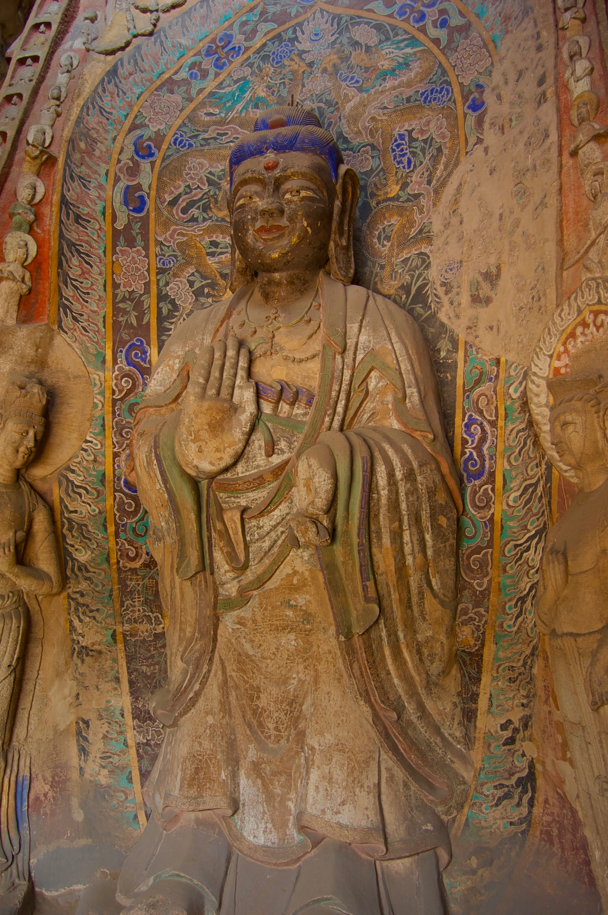 A Boddhisattva offers his blessings at a cave entrance in the Yungang Grottoes (Datong, Shanxi)