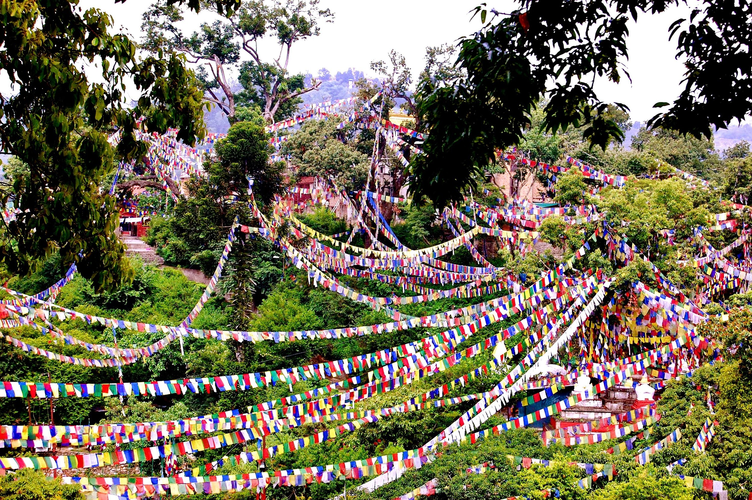 Prayer flags adorn the hills surrounding Swayambunath, also known as the Monkey Temple (Kathmandu, Nepal)