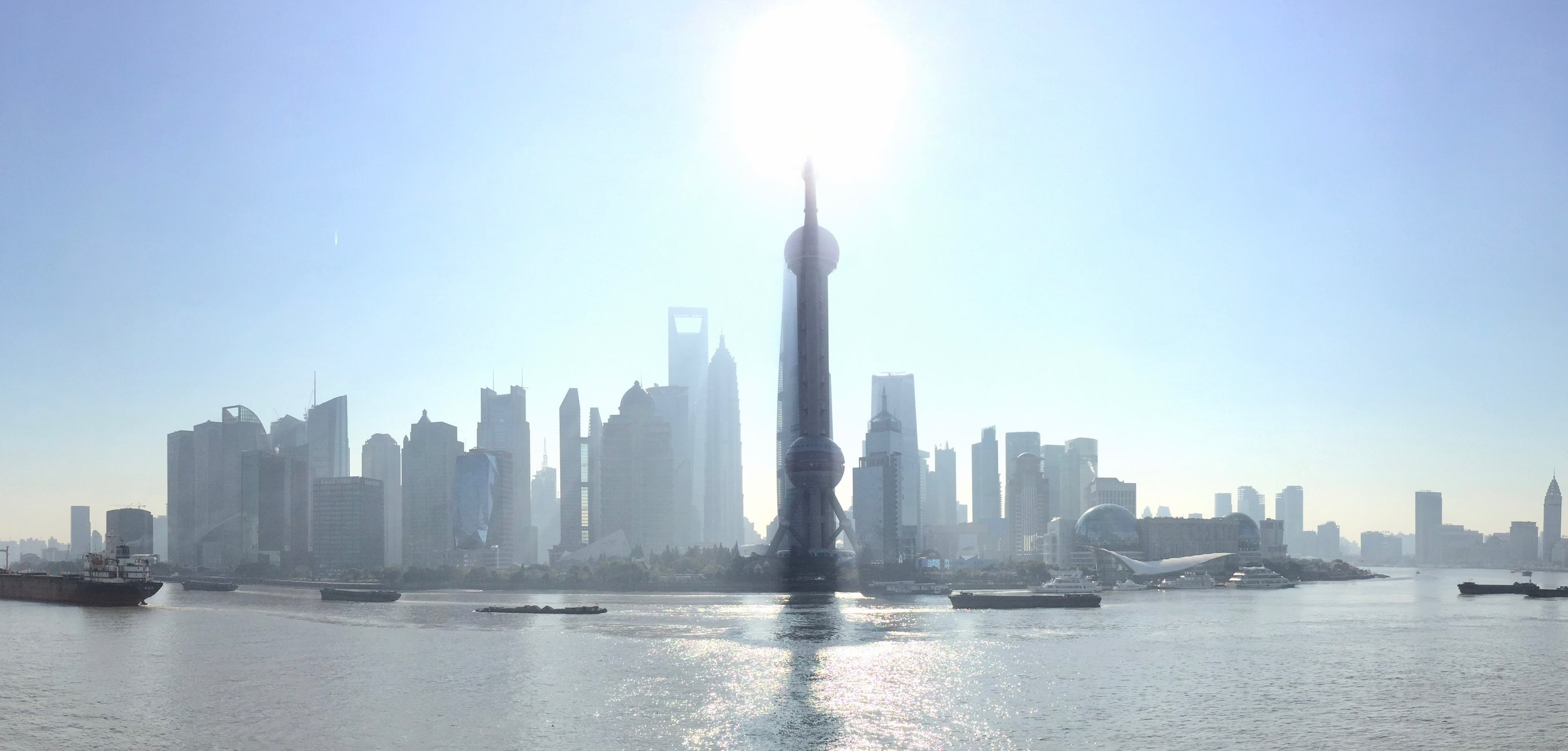 Morning view of the Huangpu River and the Puxi Financial Center from the Bund (Shanghai, China)
