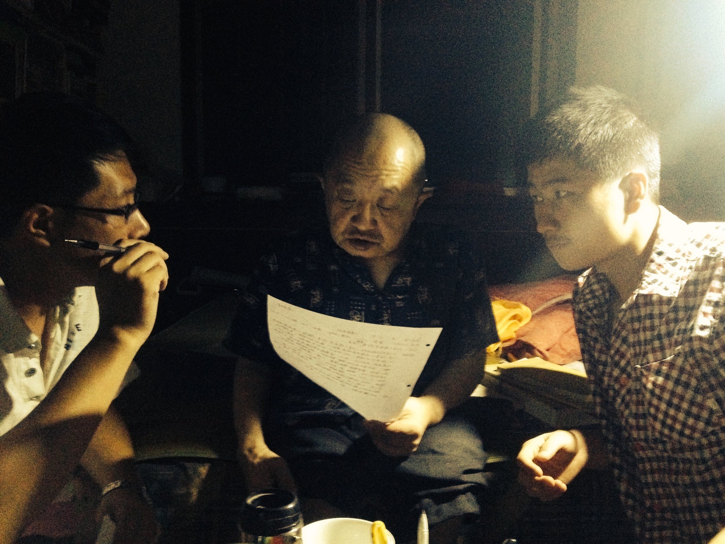 Dr. Sun Manzhi reviews a patient's chart with two of his students (Weinan, Sha'anxi)