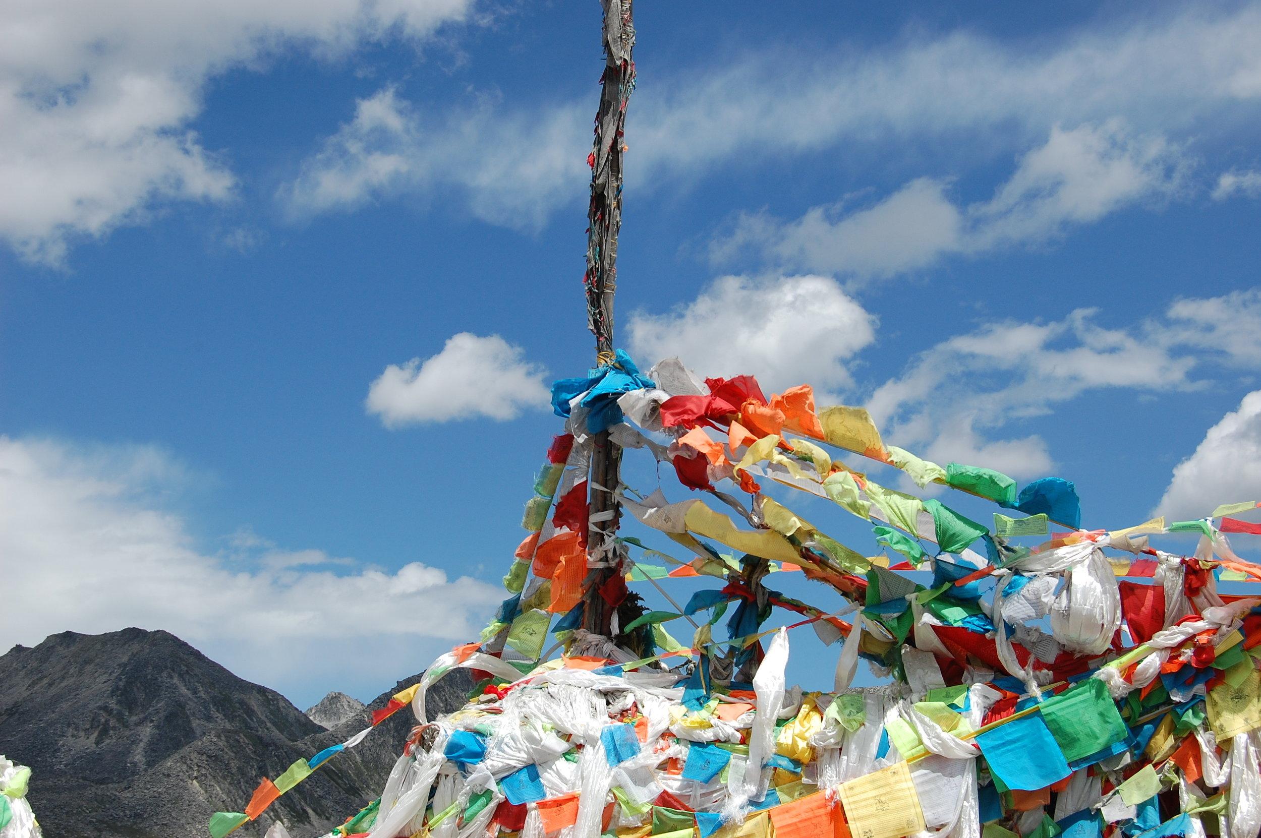 Prayer flags atop Kangding Mountain Pass (Sichuan, China)