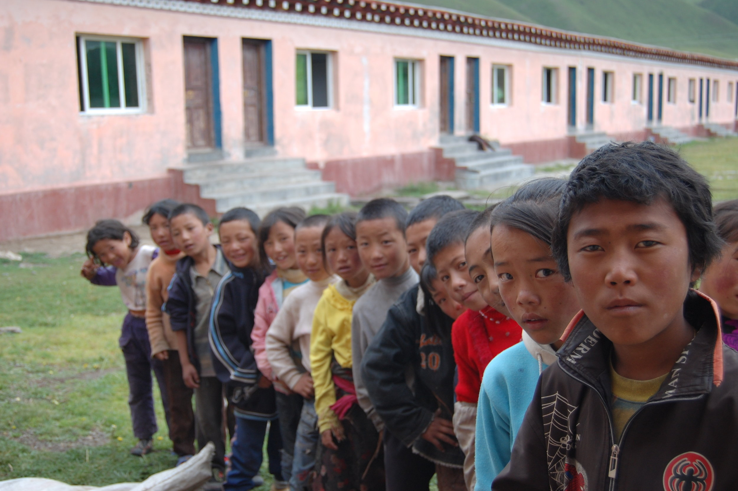 Curious Tibetan youths line up for a general health check (Kham Region, Sichuan)