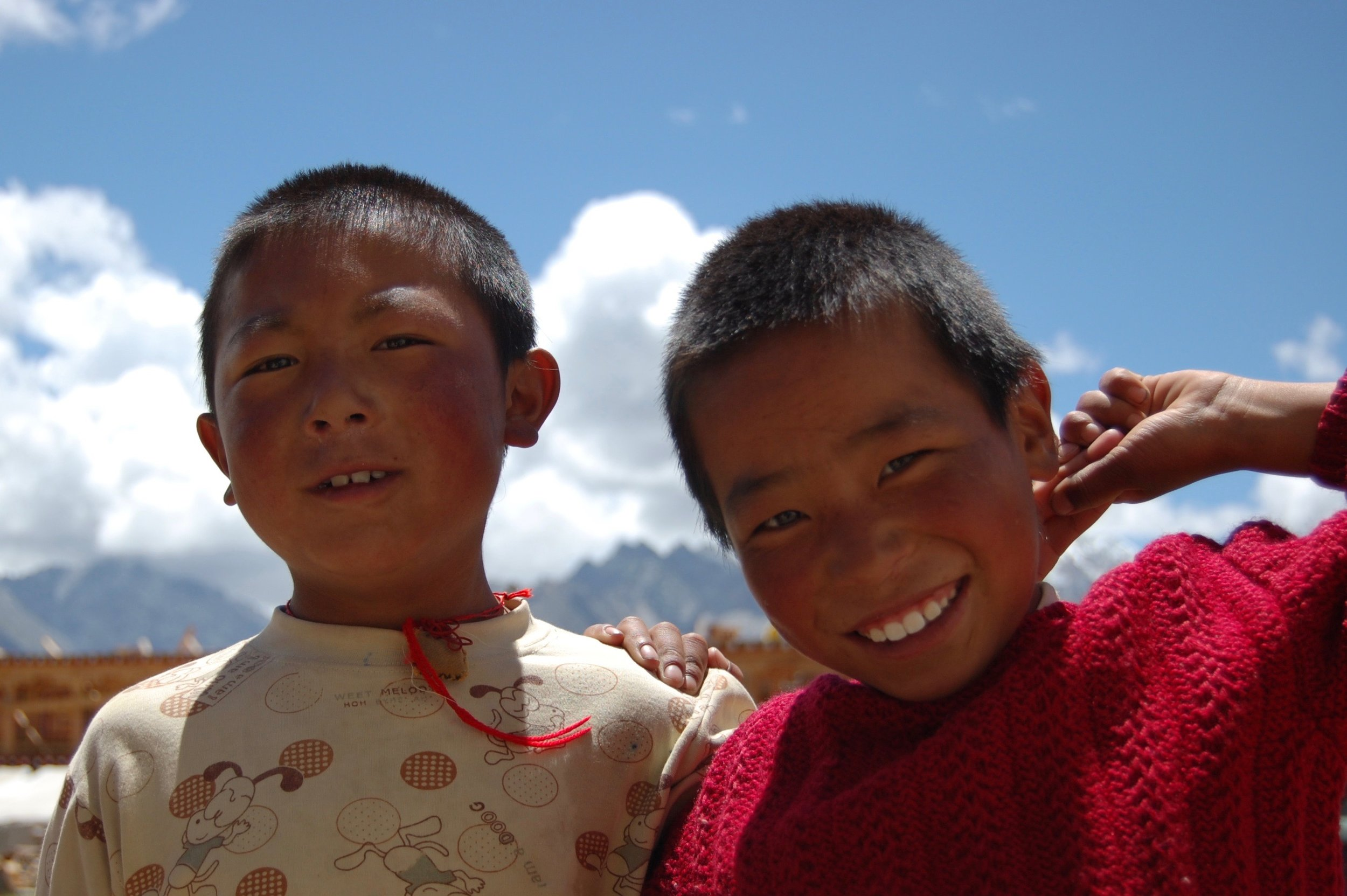 Two Tibetan youngsters smile for the camera (Kham Region, Sichuan)