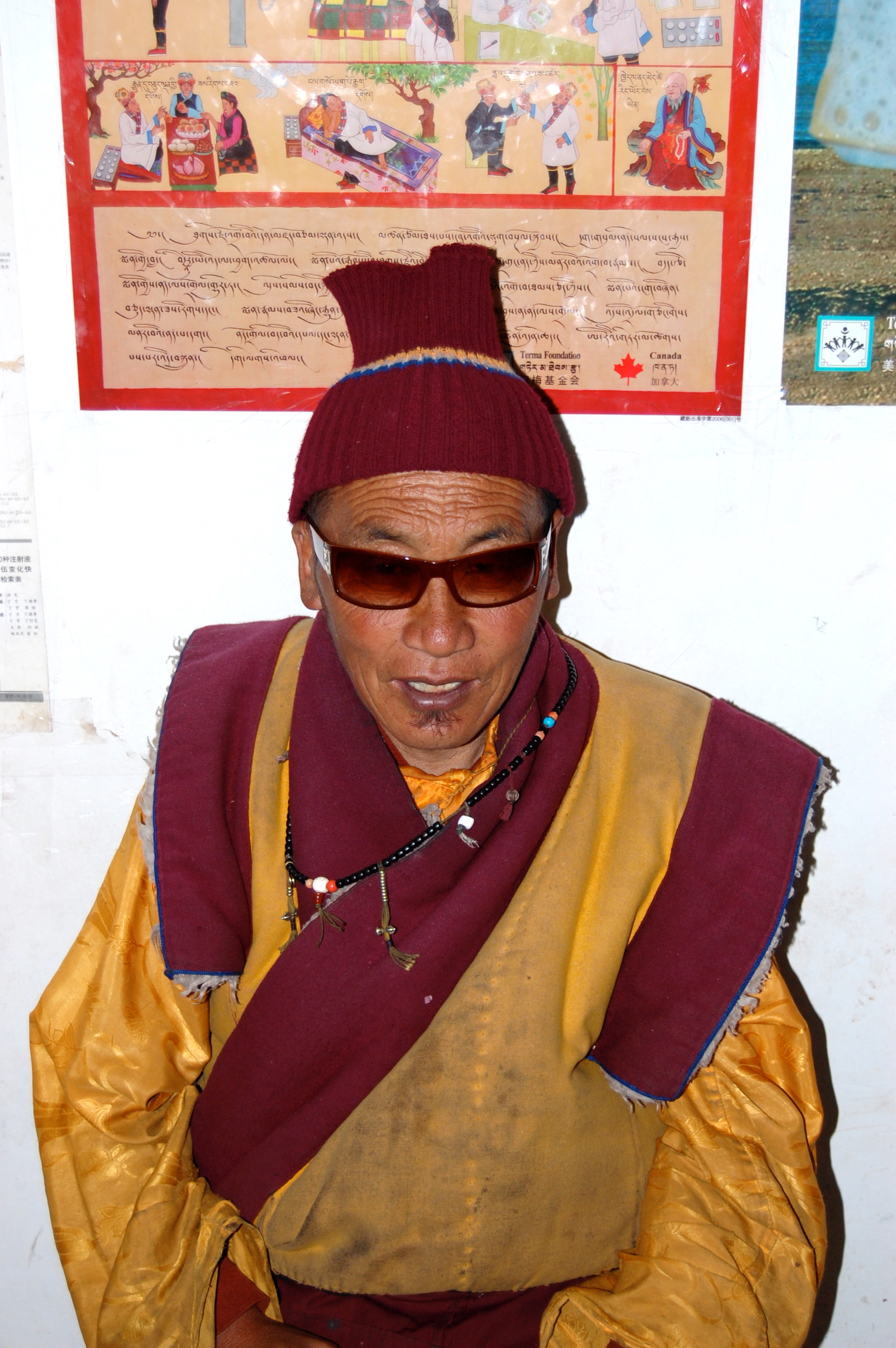 Local hipster sporting one of several thousand pairs of knockoff designer shades Dorje distributed to prevent eye damage from the high altitude sun (Kham Region, Sichuan)