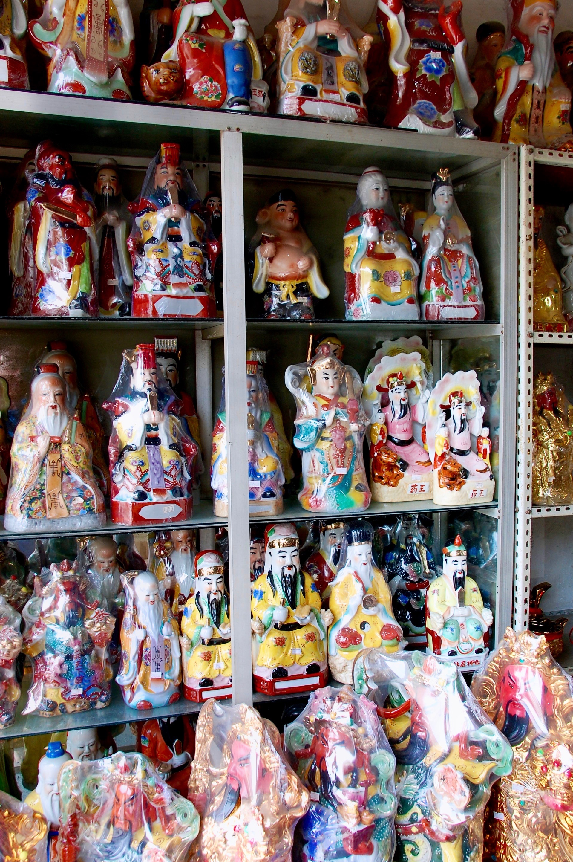 Colorful Taoist deities smile down from the shelves (Henan, China)