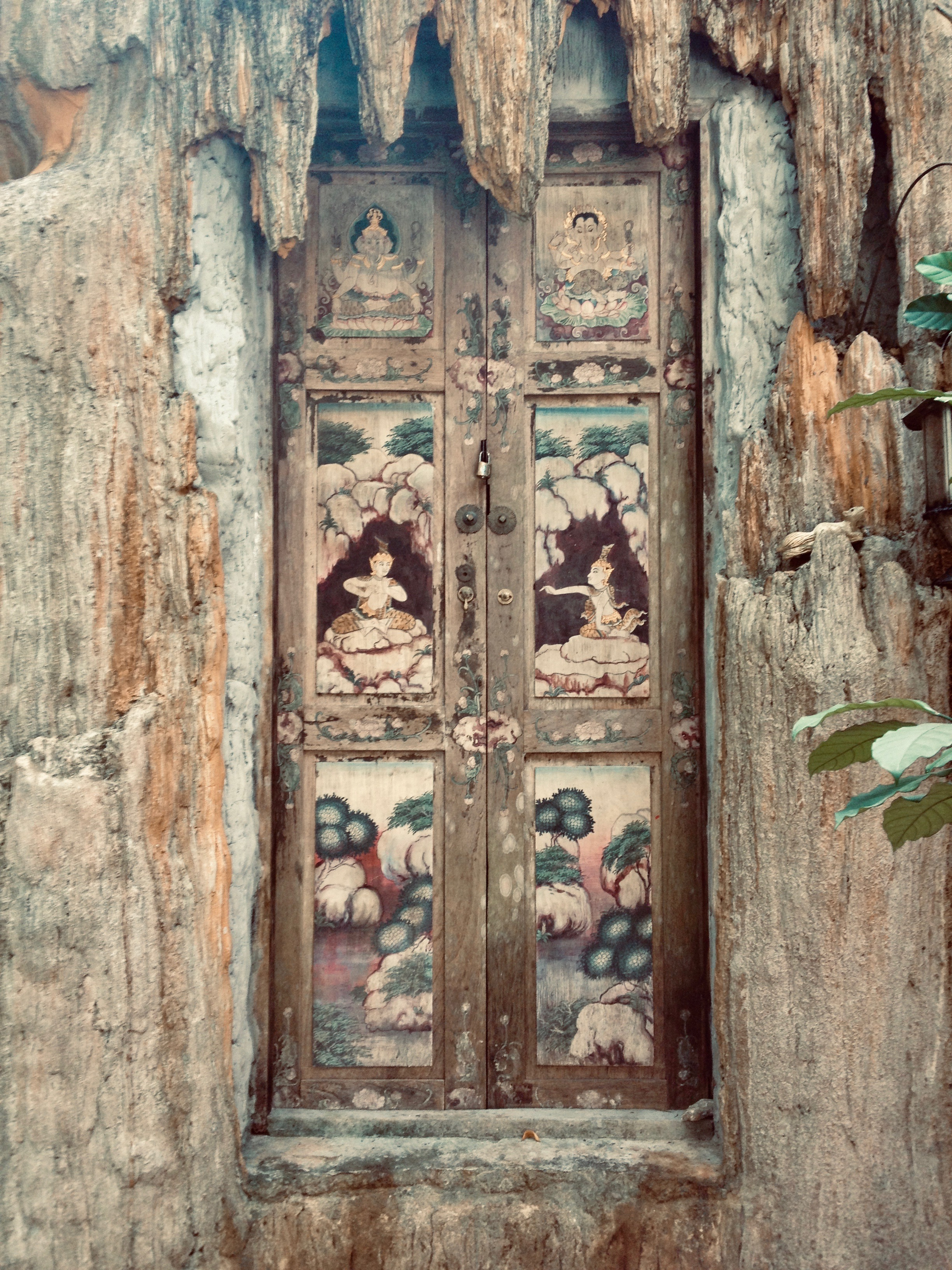 Beautiful artwork on the door panels of the entrance to this retreat cave high above the city (Chiang Mai, Thailand)