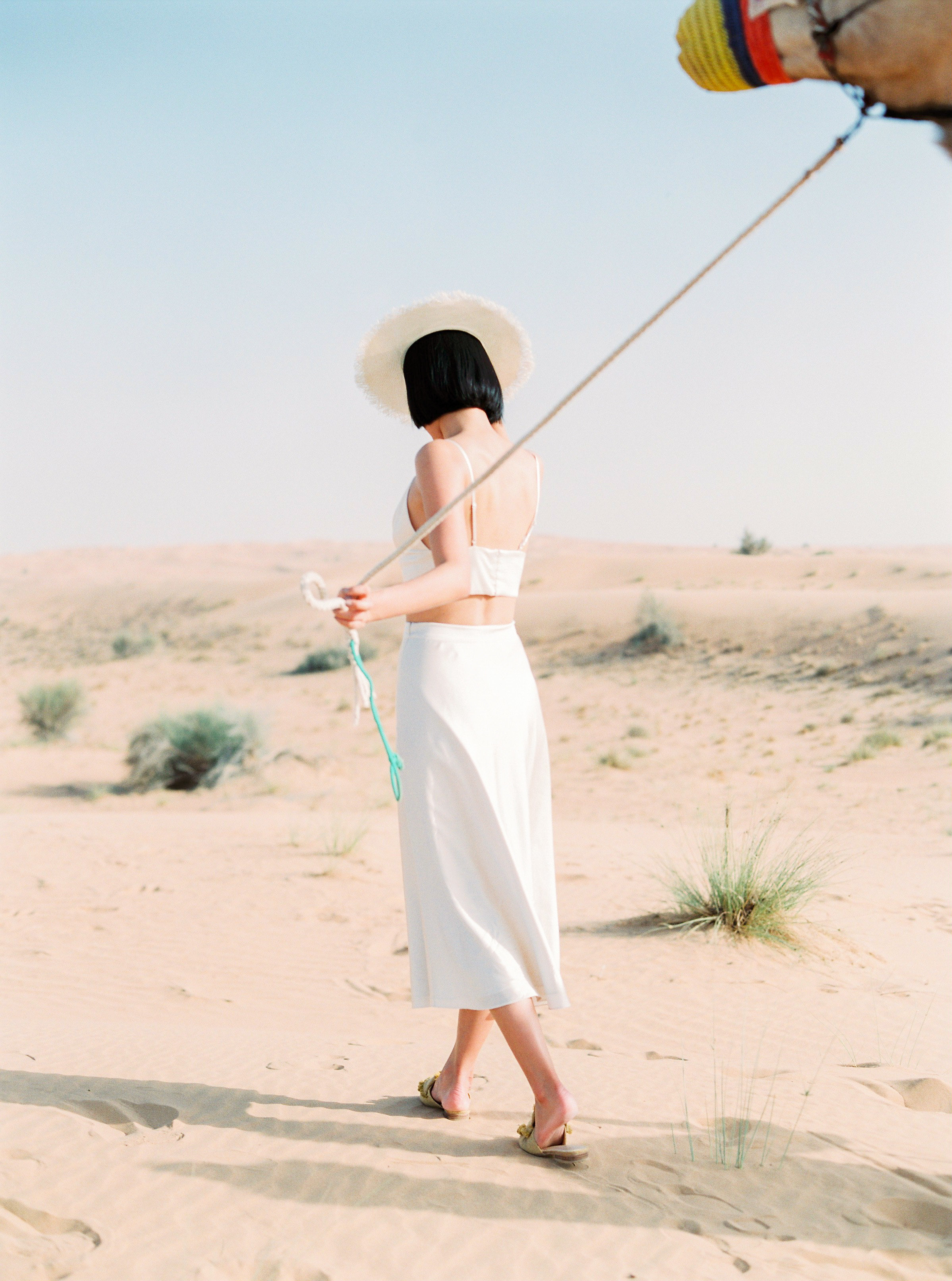 Maggie wears the Bustier Top and Midi Silk Skirt from her silk collection in her honeymoon shoot in Dubai. Photography:  Maria Sundun Photography .