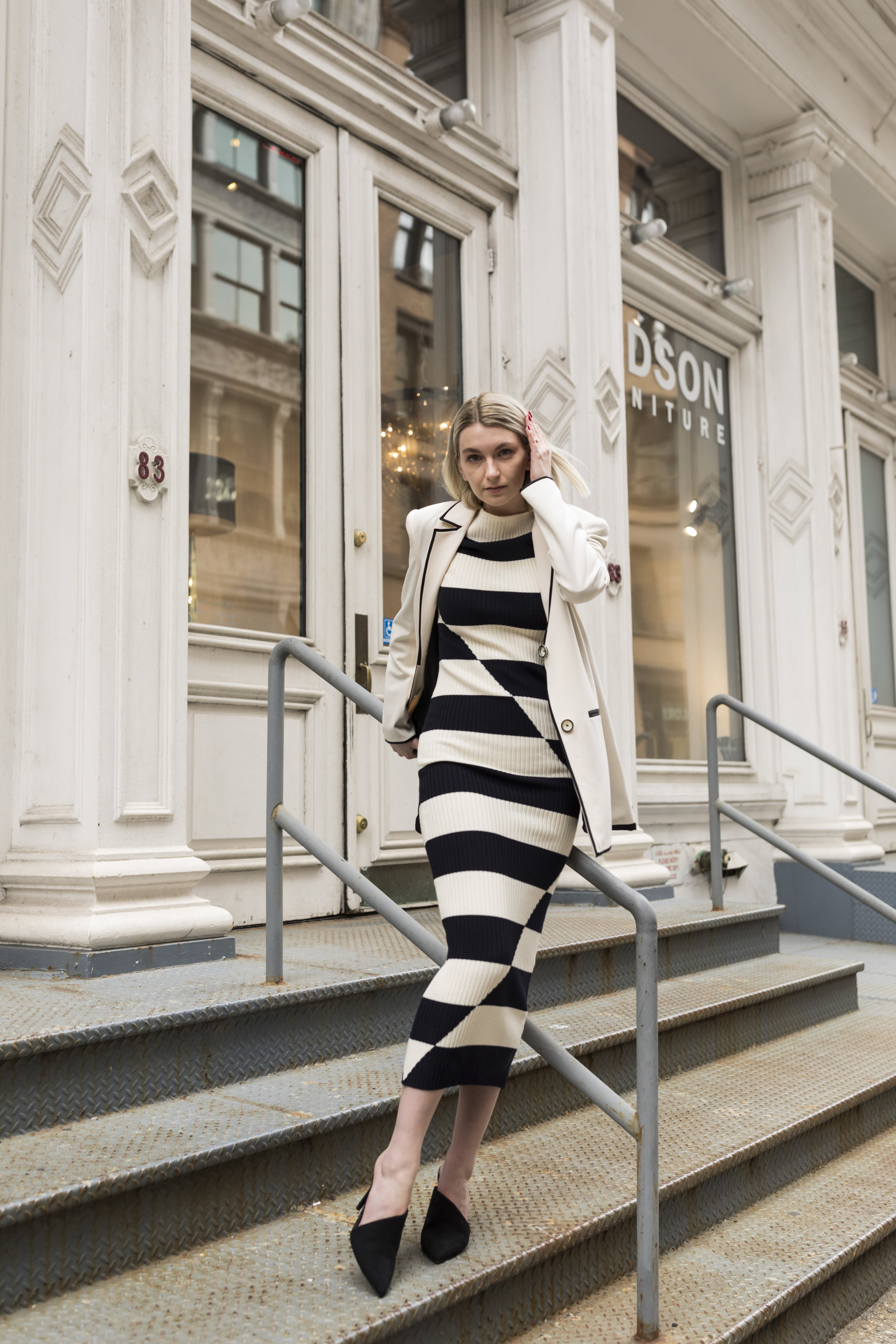 Madison,  @madisonrussellx , looked beautiful in Donna's Fall '19 collection striped dress. We love the monochrome color scheme with the clean, white jacket and black heels.