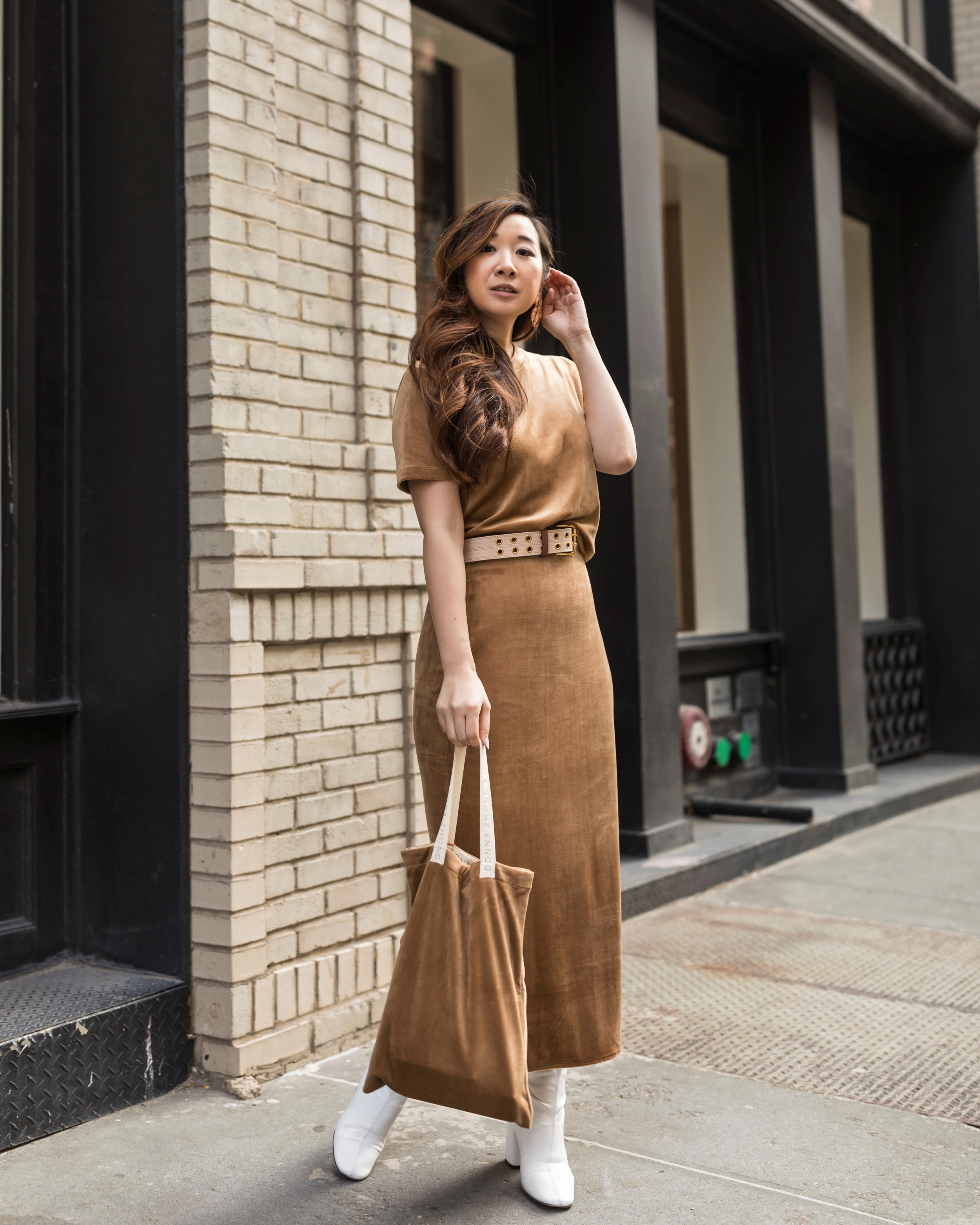Our #bosslady Tricia Chen,  @happilyeverstyle , wearing a Donna Zhong Official matching  camel top  and  skirt  while holding one of the velvet goodies bags made by Donna!