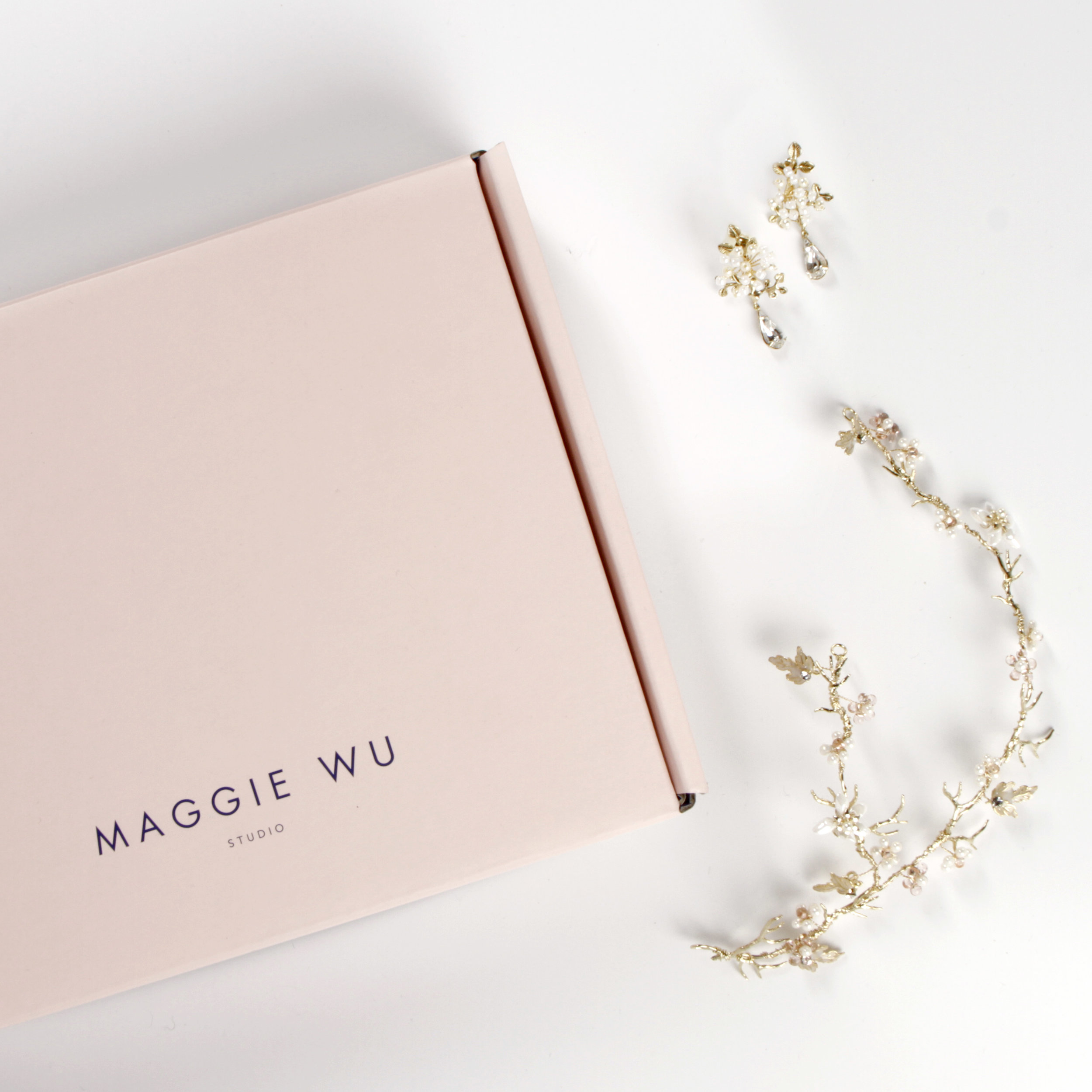 The perfect pairing for the modern bride, Maggie Wu Studio's Perfect Bridal Accessories Set includes a  Aria Headpiece  and  Ria Earrings .