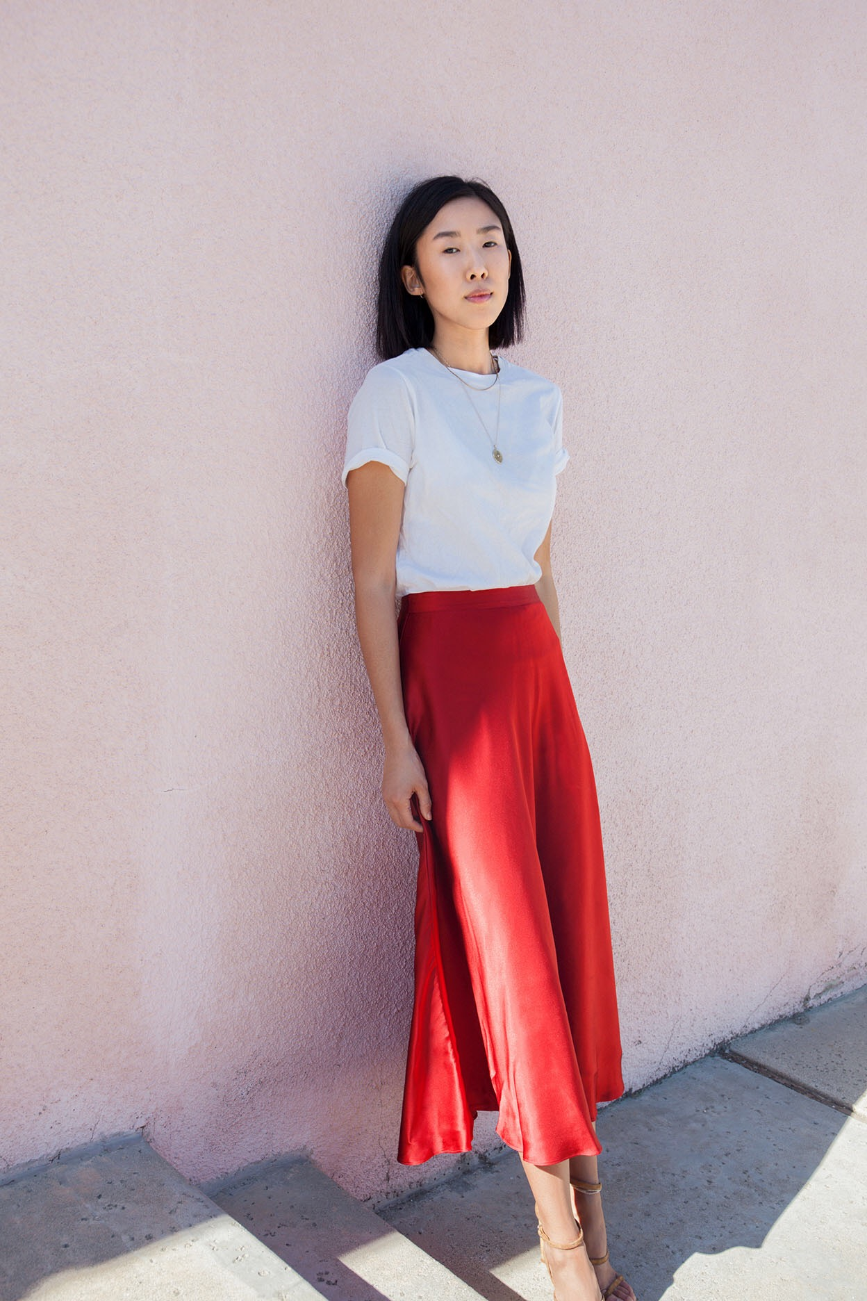 A minimal but chic look featuring the Airie Midi Skirt. Photo by  Kristine Lo .