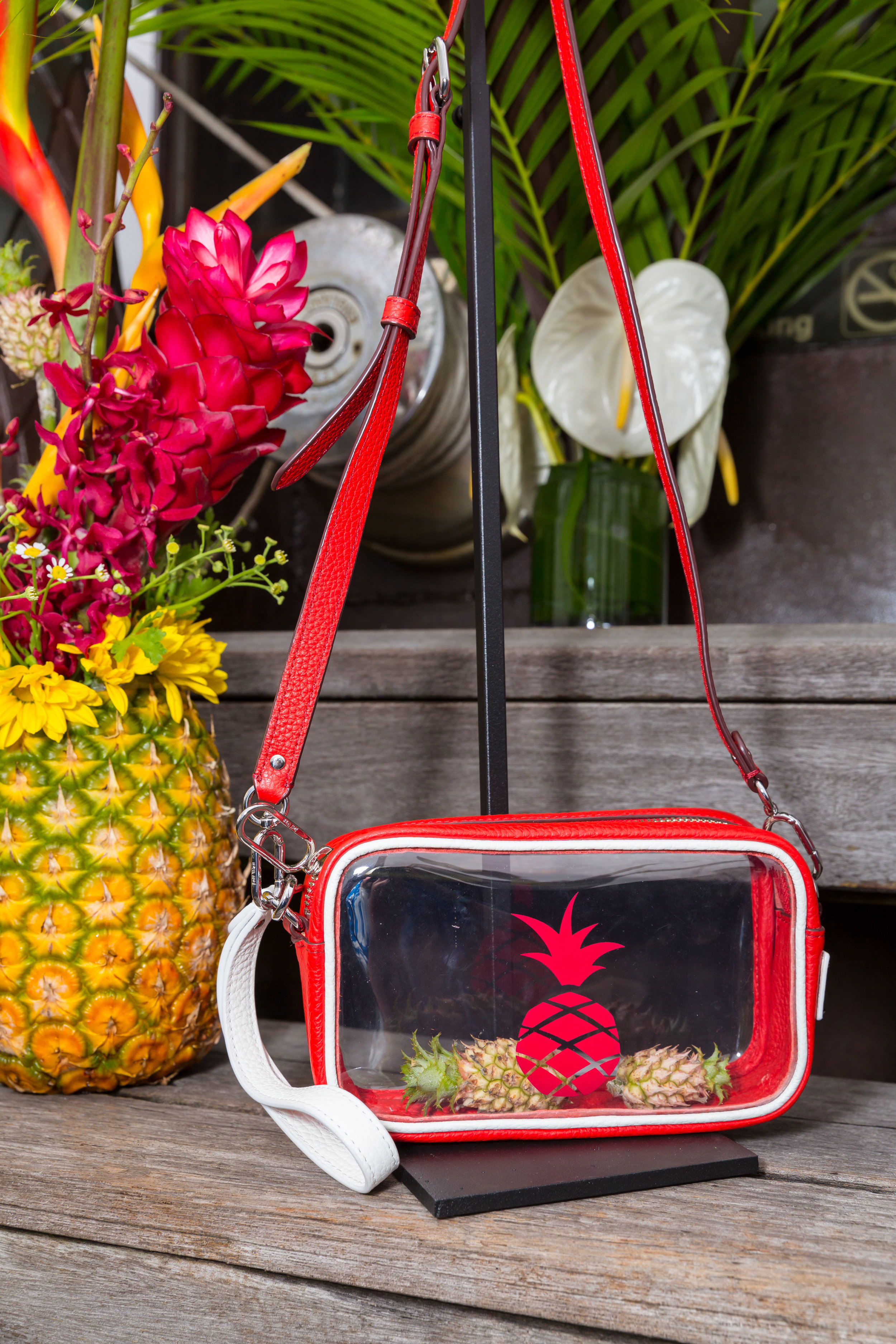 The clear cross-body bag with pineapple(s).