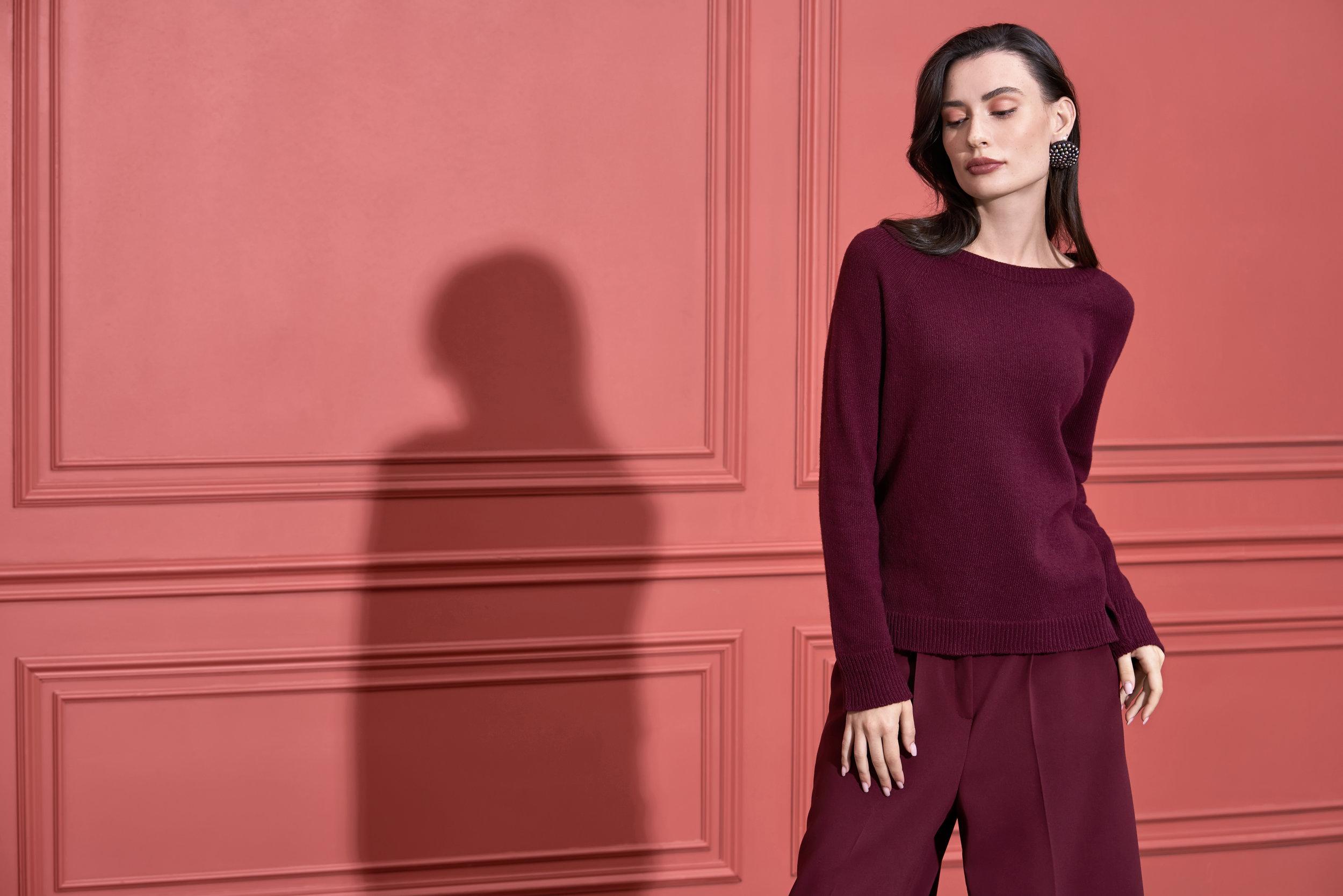 Model posing in studio in trendy clothes